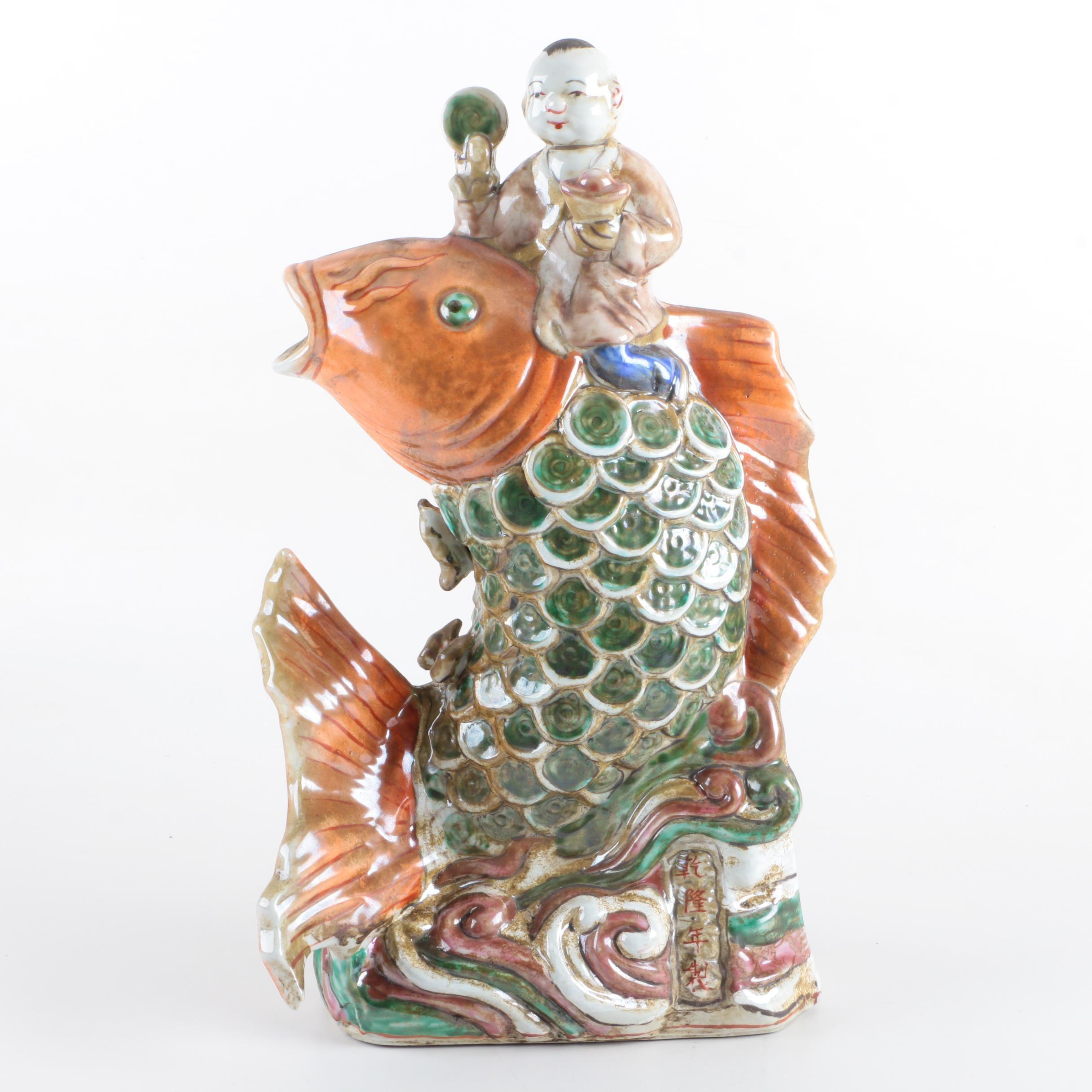 Chinese Ceramic Figurine Riding Large Koi Fish