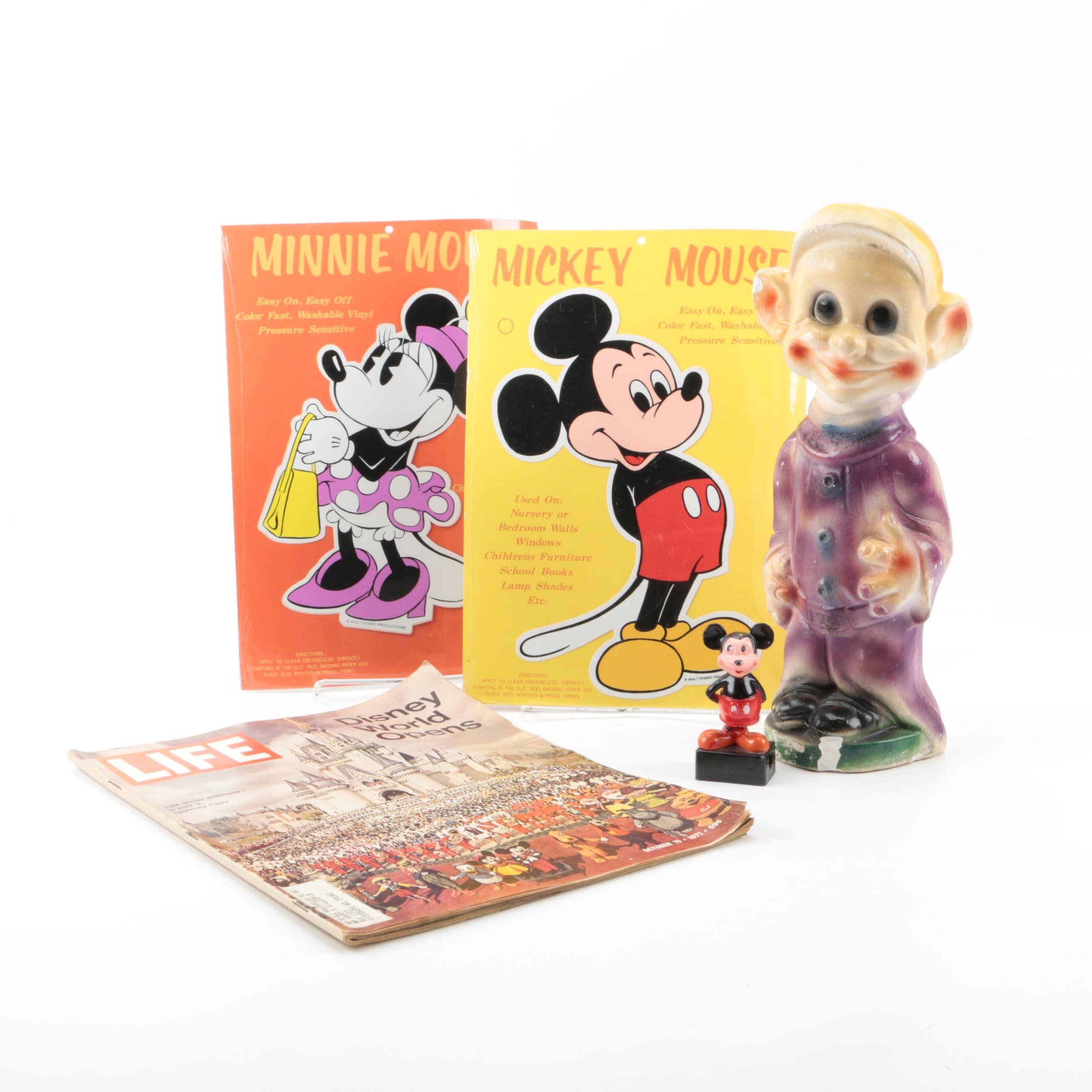 Disney Memorabilia Including Decals, Pencil Sharpener, and More