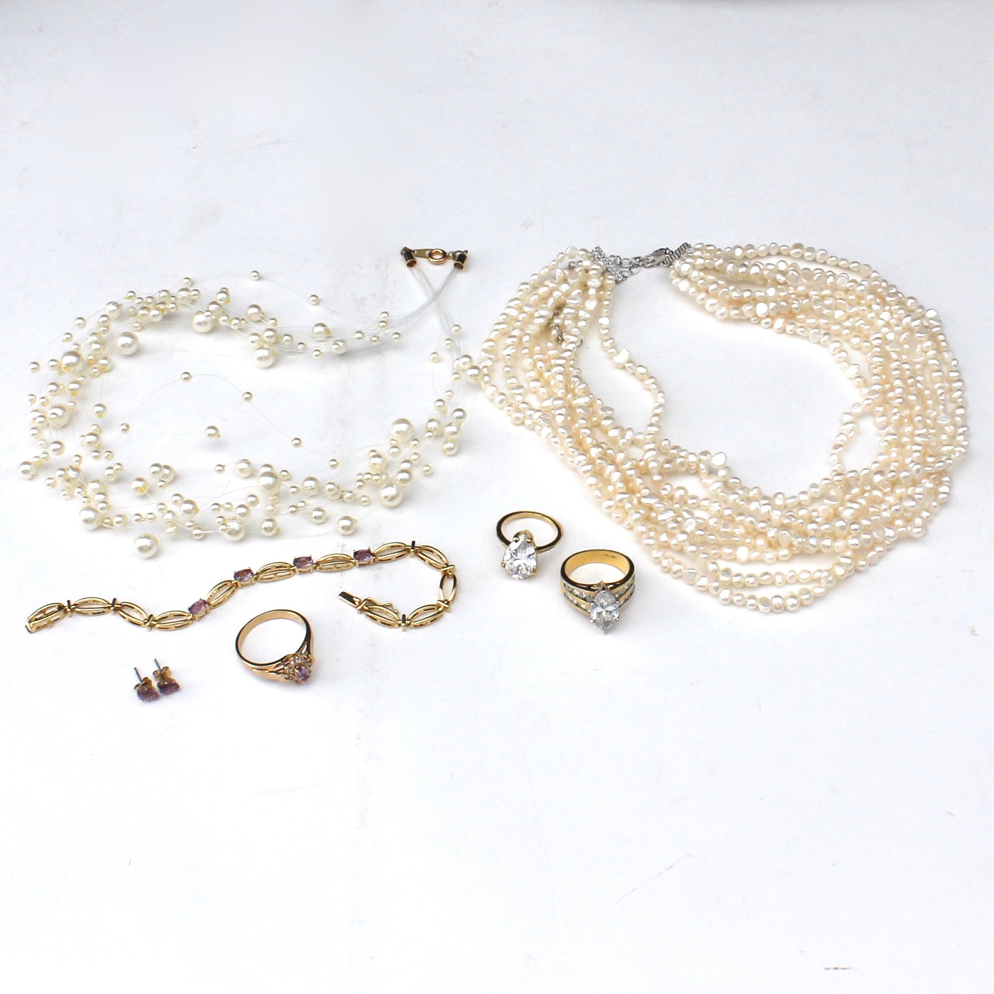 Multi-strand Pearl Necklaces, Statement Cocktail Rings, and Amethyst Jewelry Set