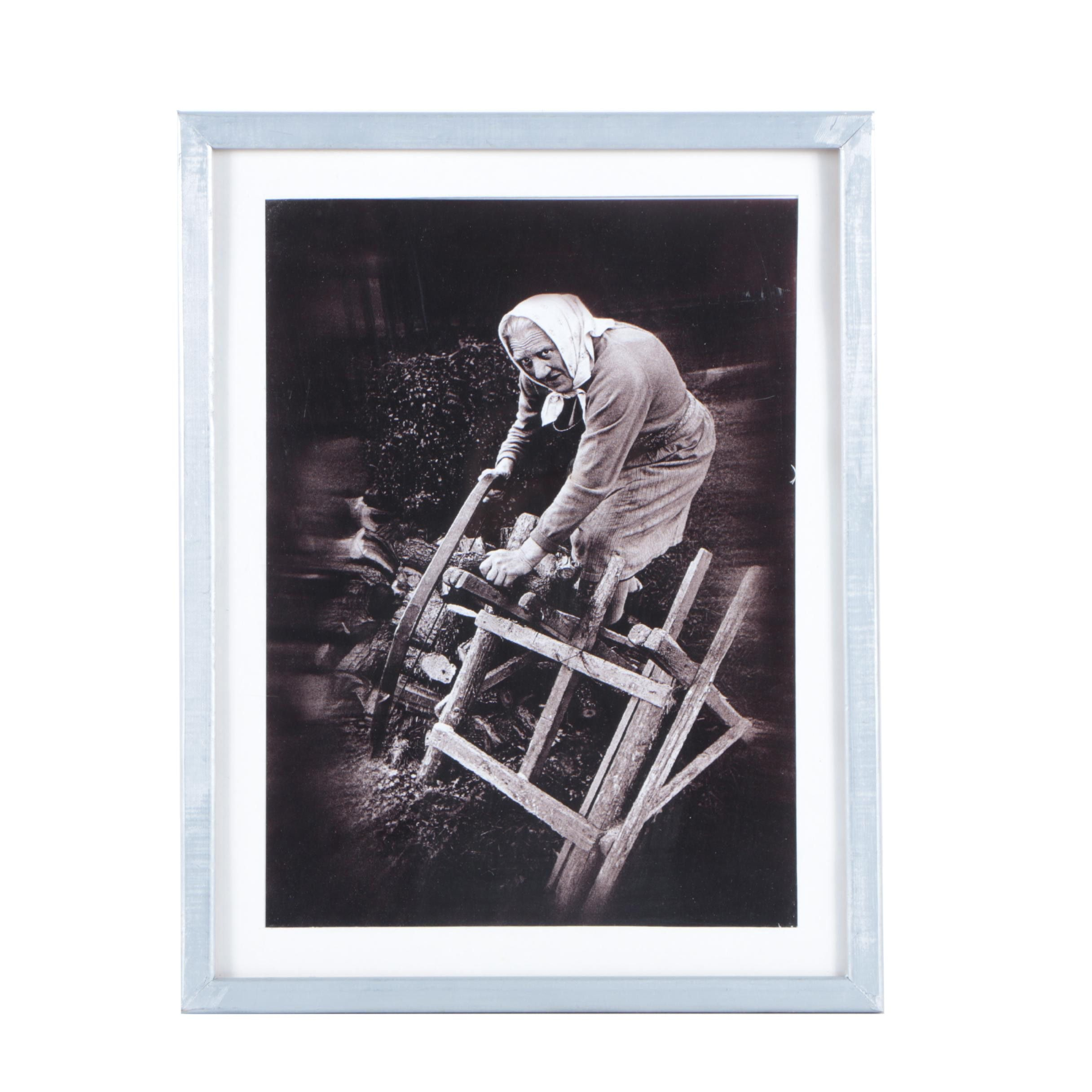 Digital Black and White Photograph on Paper of a Woman Sawing Wood