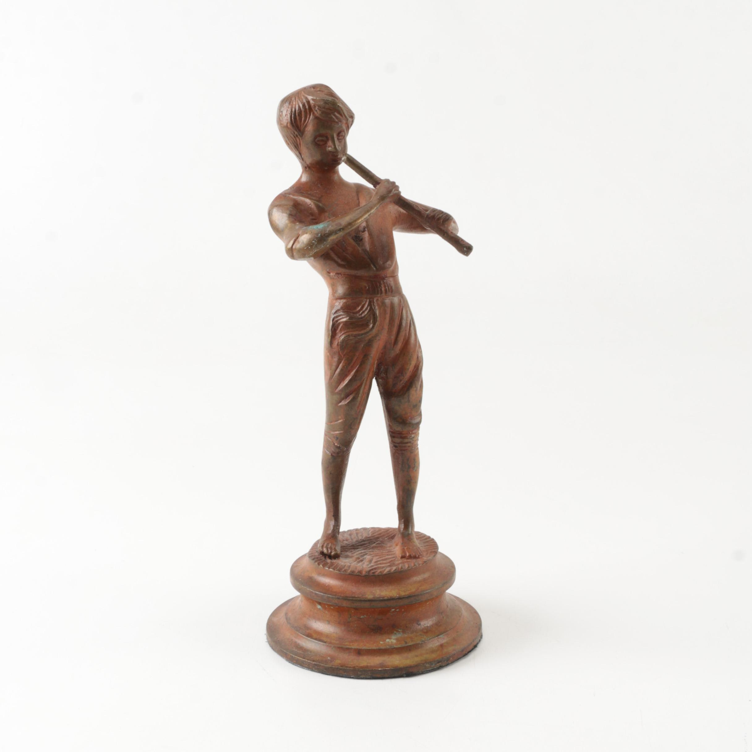 Metal Figurine of Boy Playing Flute