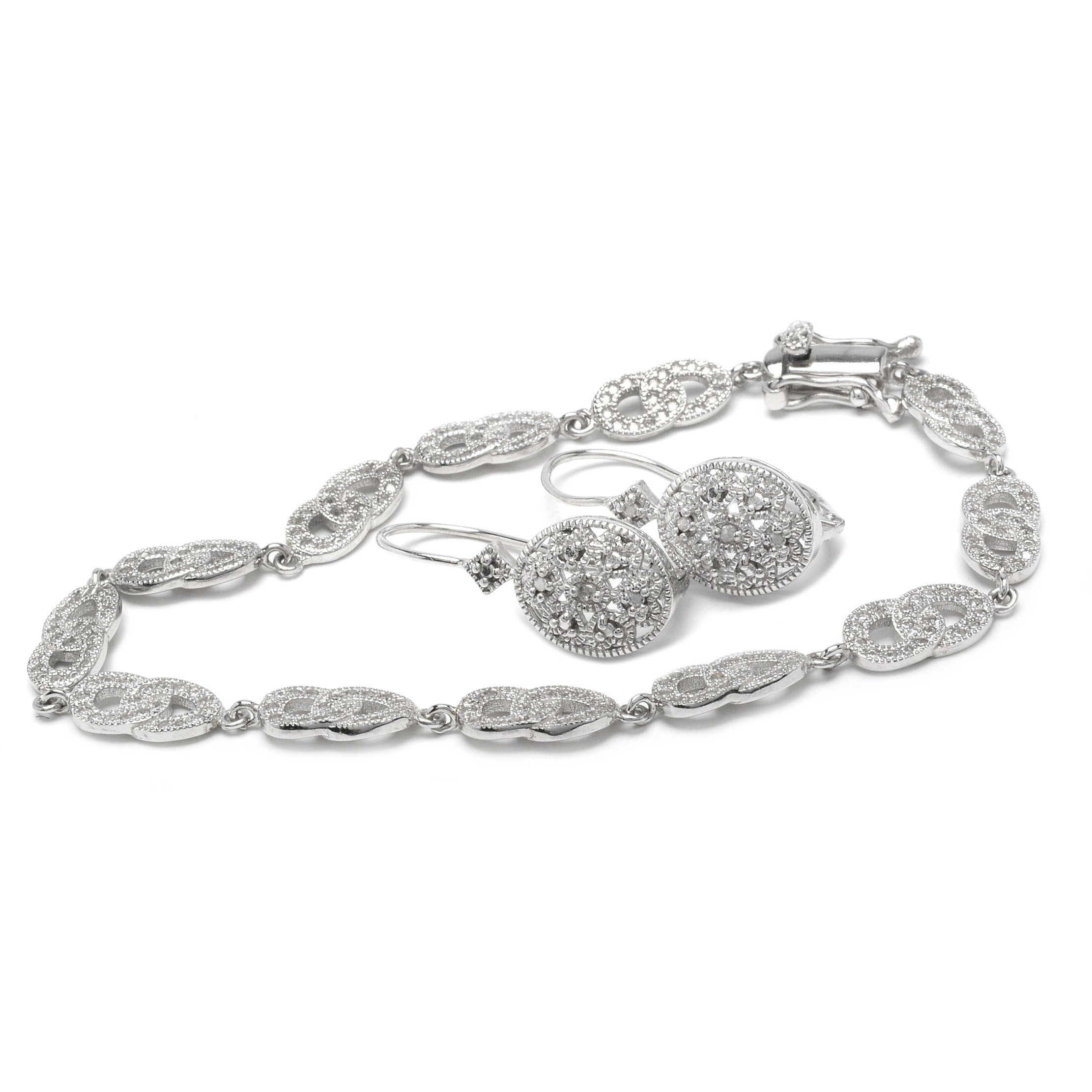 Sterling Silver and Diamond Earrings with a Cubic Zirconia Bracelet