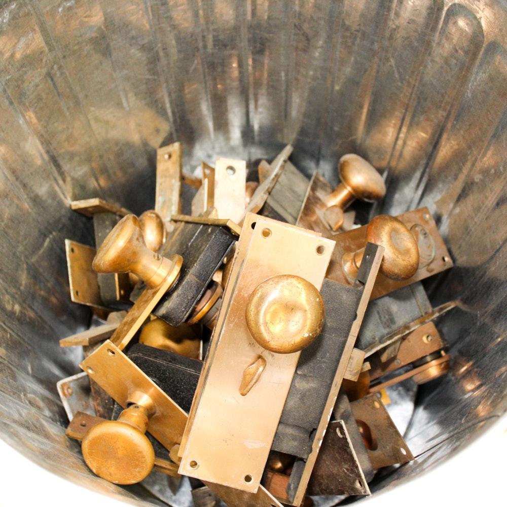 Brass Door Hardware in Galvanized Trash Can