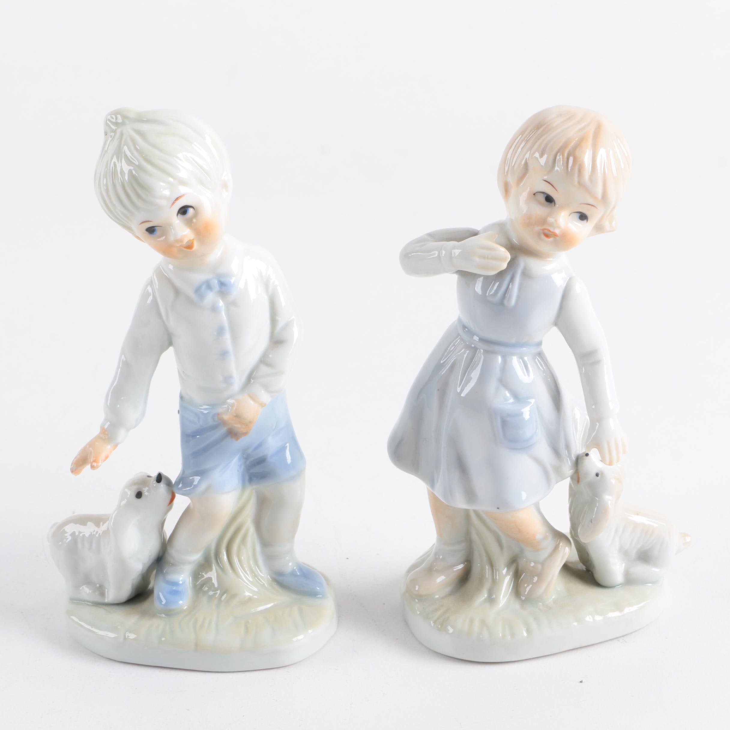 Porcelain Figurines of Girl and Boy