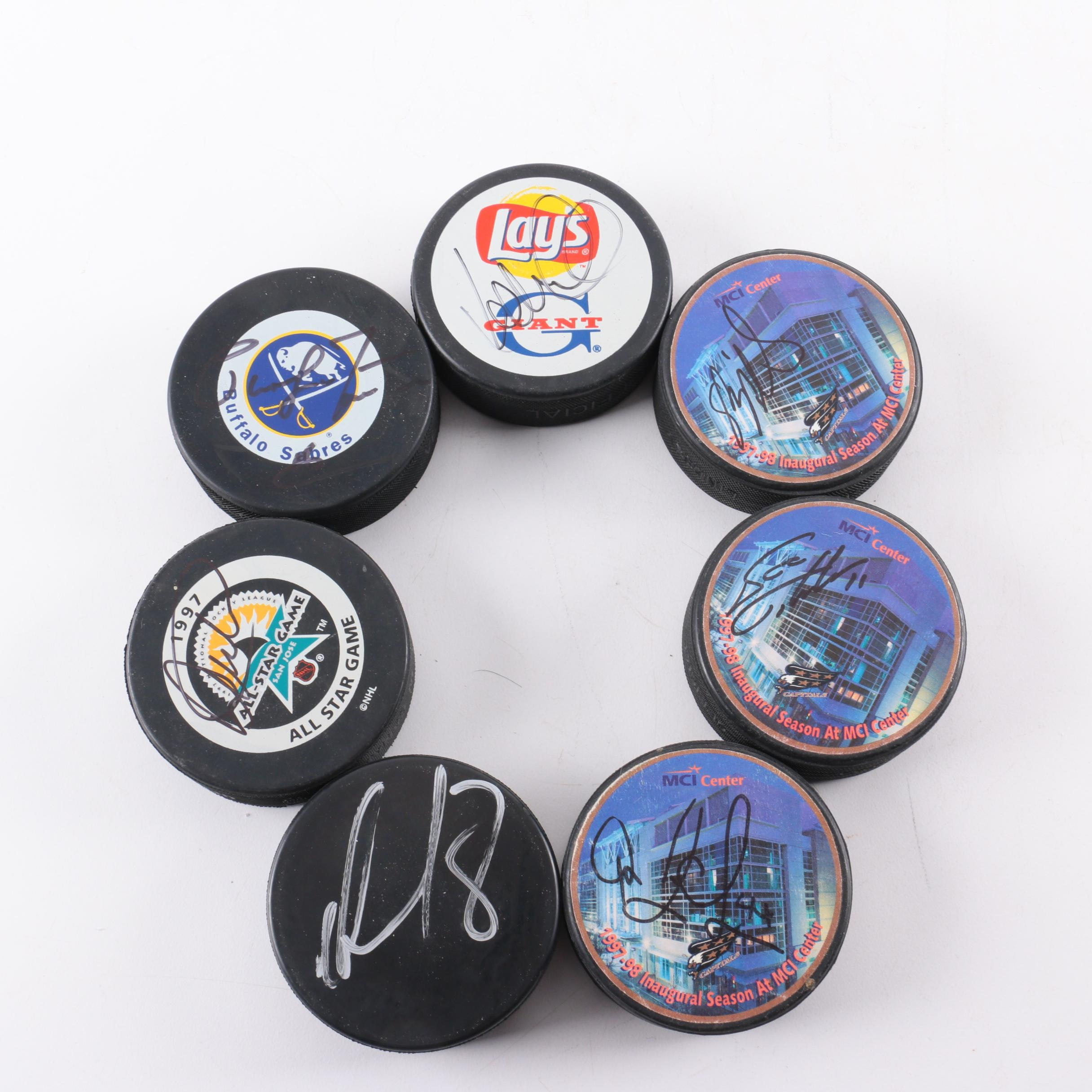 Collection of Autographed Hockey Pucks