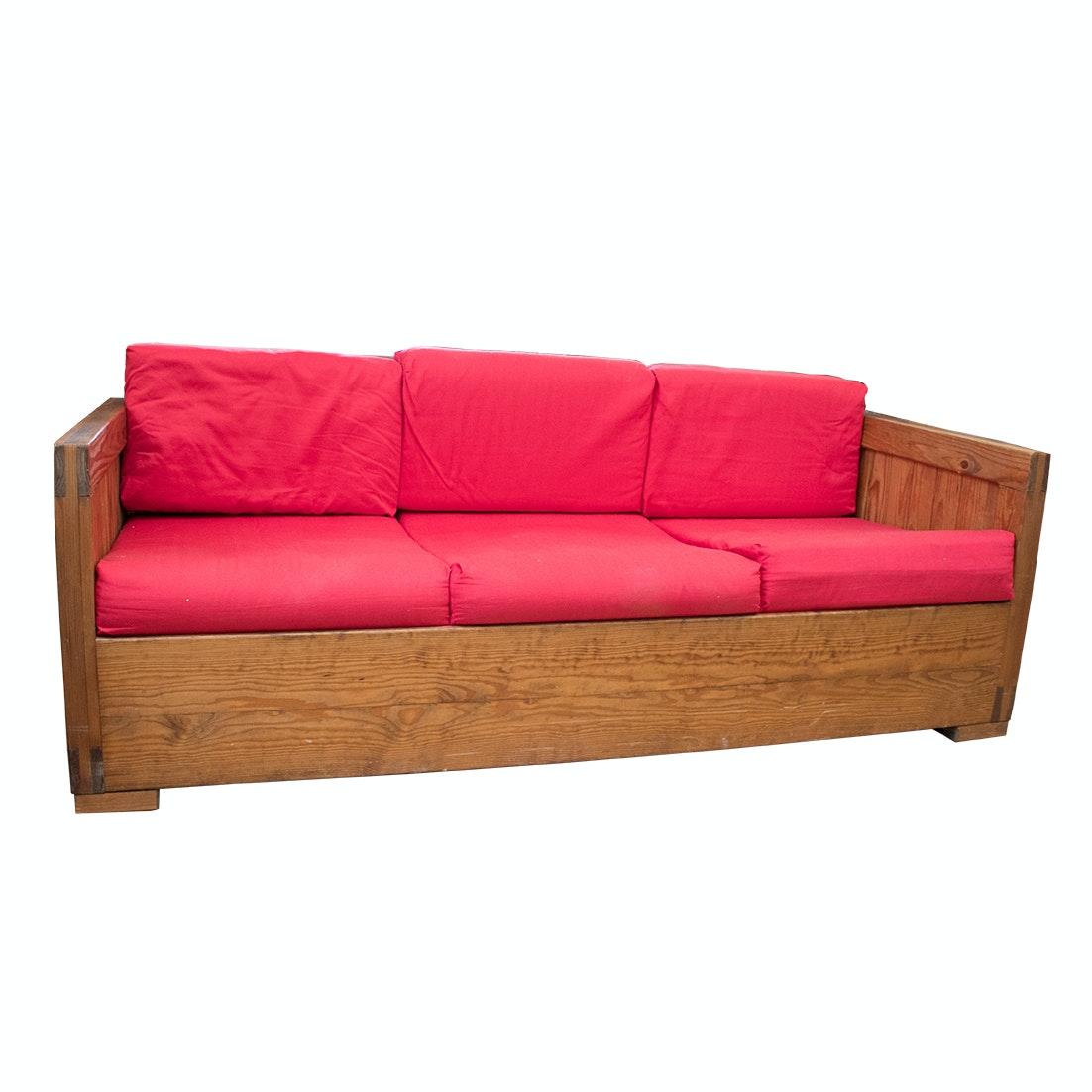 Vintage Wood-Framed Sofa with Red Cushions
