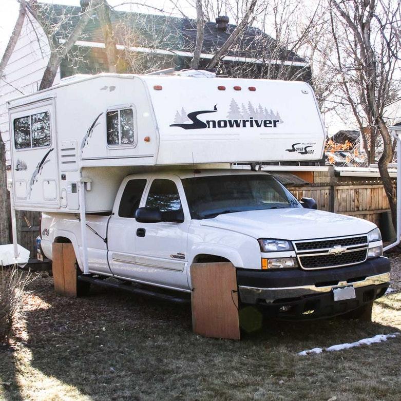 2005 Chevy Silverado with Snow River Truck Camper