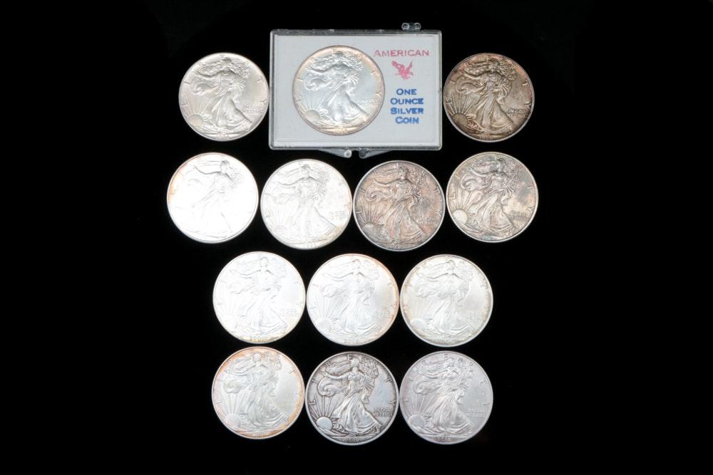 Thirteen American Eagle One Dollar Silver Coins