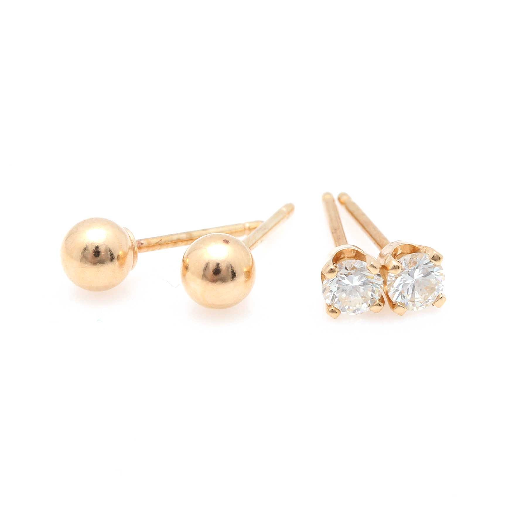 Two Pairs of 14K Yellow Gold Stud Earrings Including Diamonds
