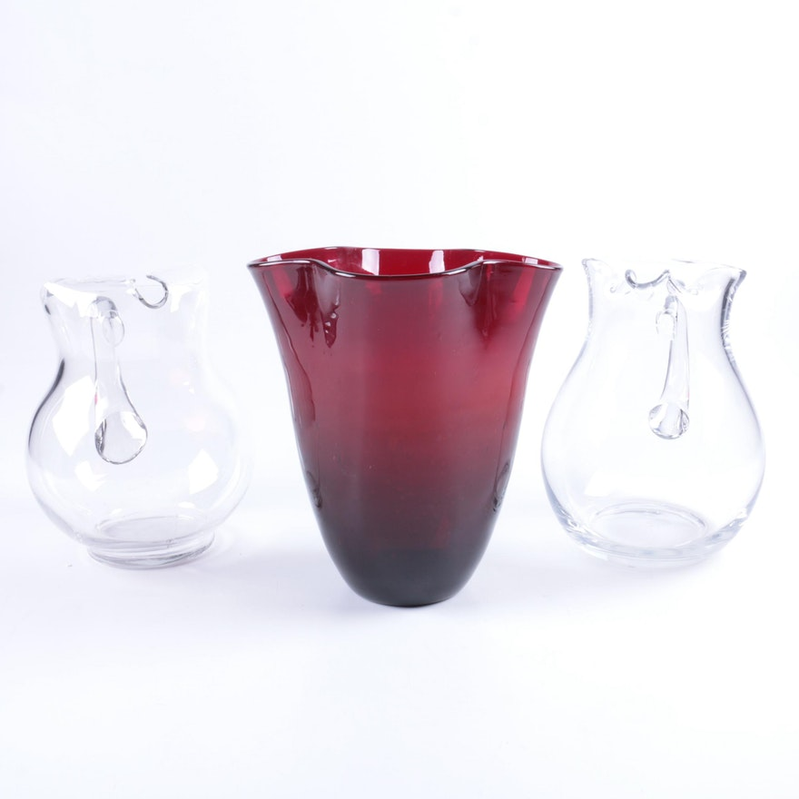 Ruby Glass Flower Vase And Clear Glass Pitchers Ebth