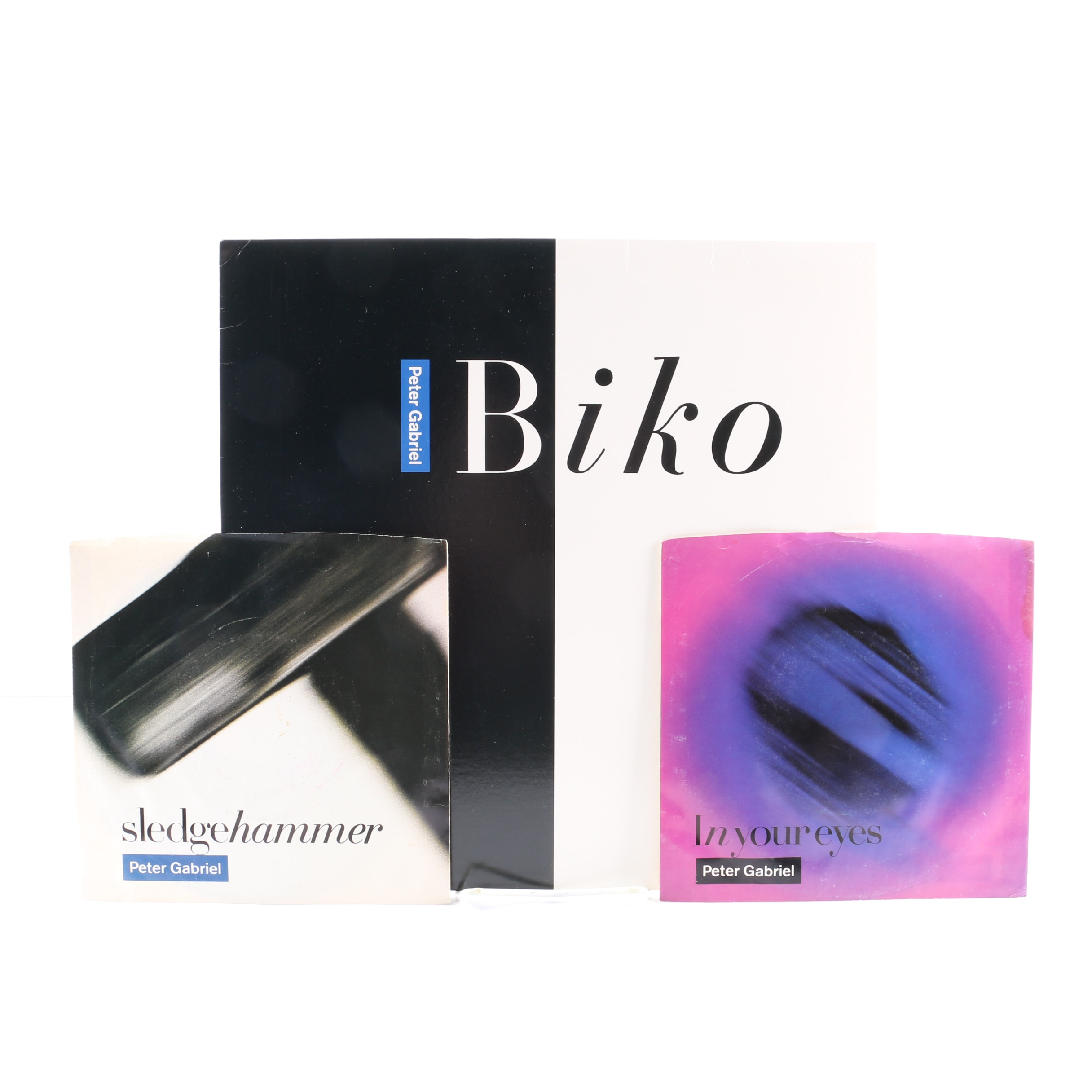 "Peter Gabriel 12"" Single and 45 rpm Records Including ""Biko"" and ""Sledgehammer"""