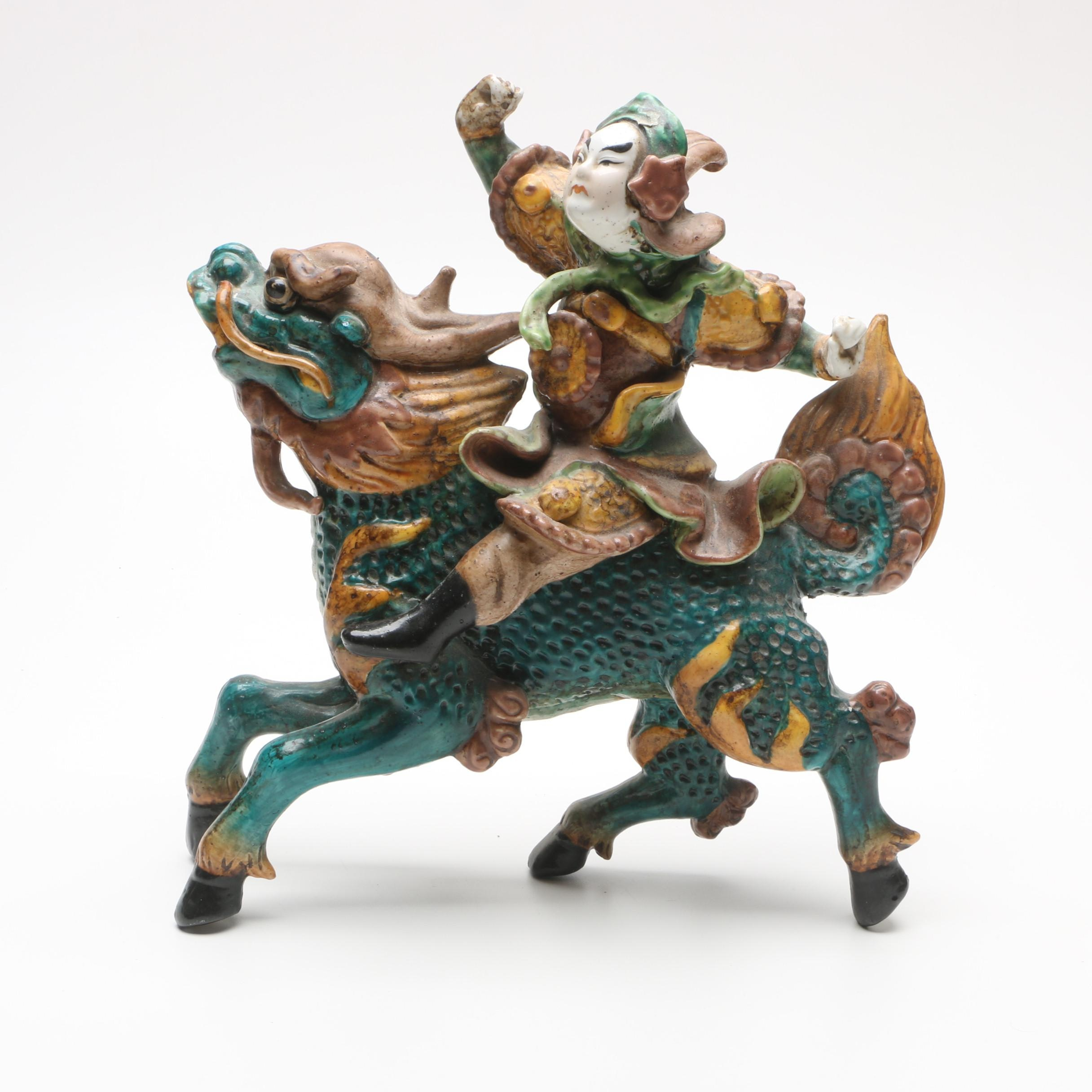 Chinese Ceramic Figurine Featuring Man Riding Mythical Qilin