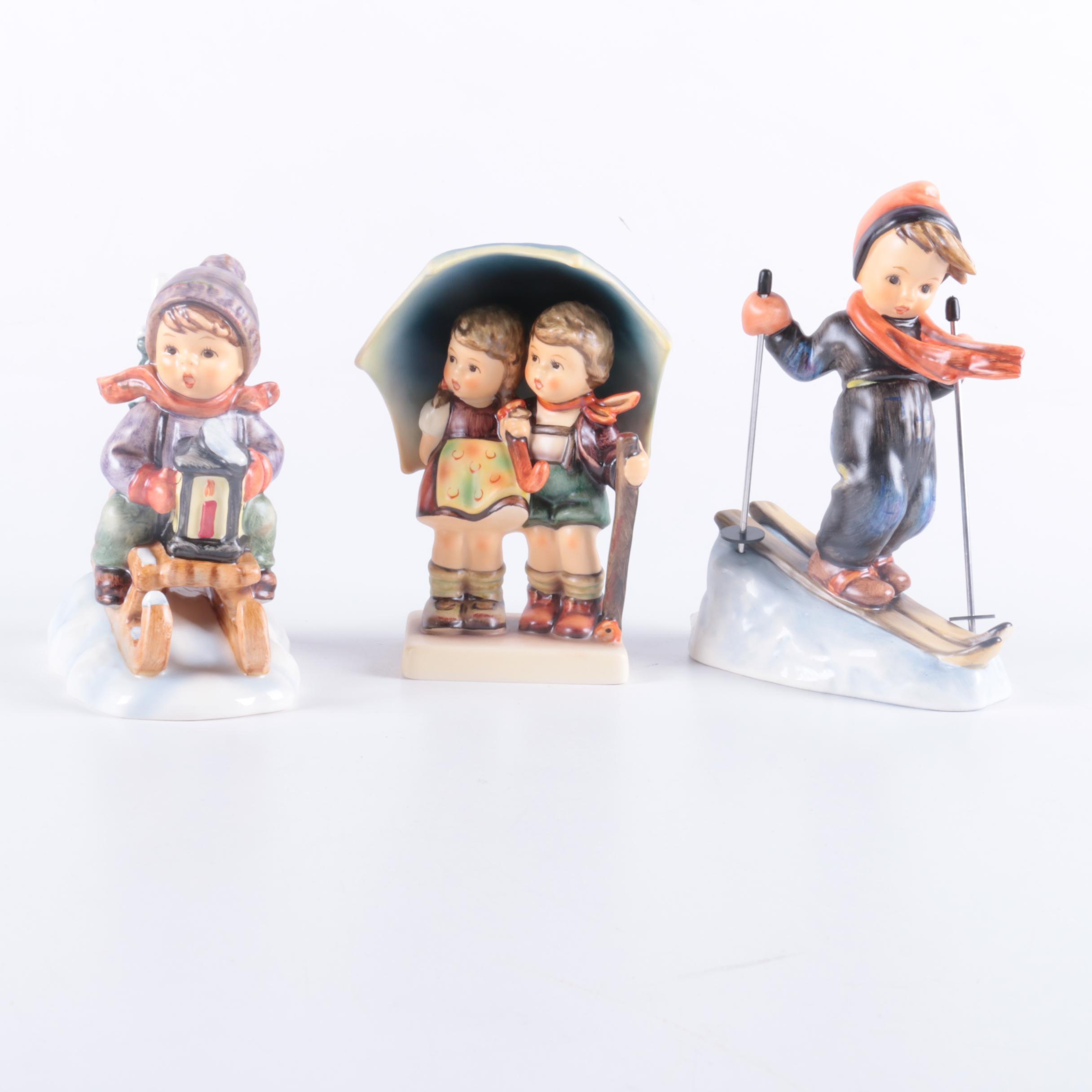 "Three Goebel Hummel Figurines Featuring ""Stormy Weather"""