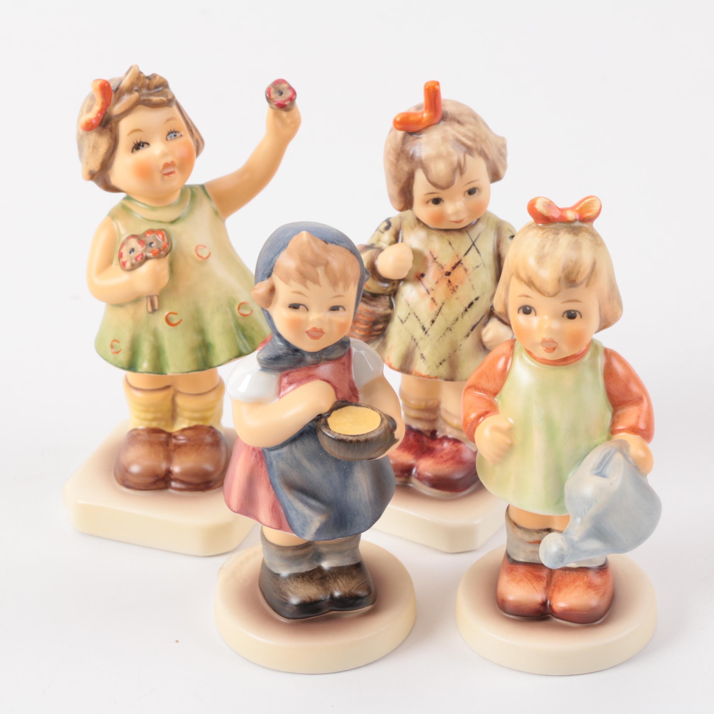 Goebel Hummel Figurines Featuring an M.I. Hummel Collector's Club Figurine