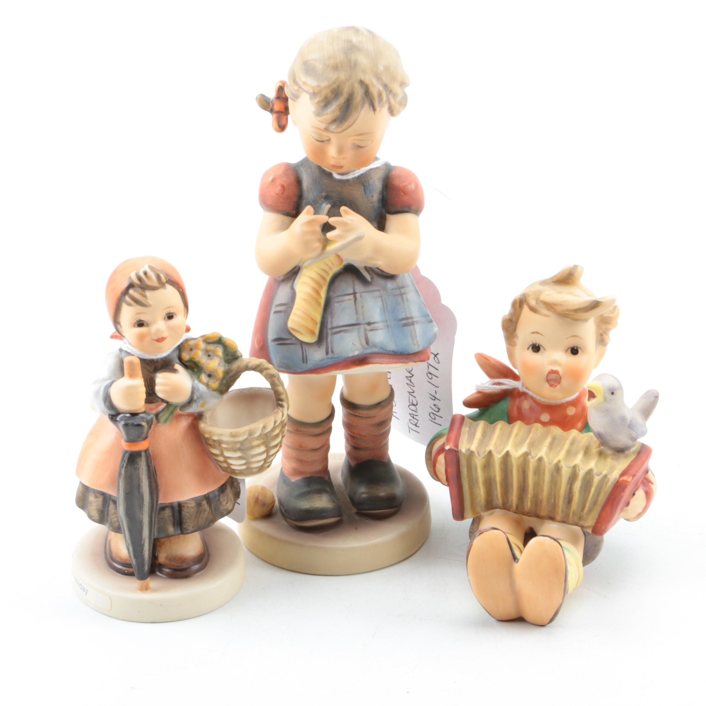 """Hummel Figurines Featuring """"On Holiday,"""" """"A Stitch in Time,"""" and """"Let's Sing"""""""