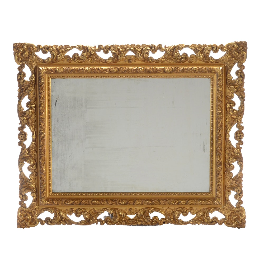 Antique Wall Mirror in Ornate Gilt Finish Wood and Gesso Frame