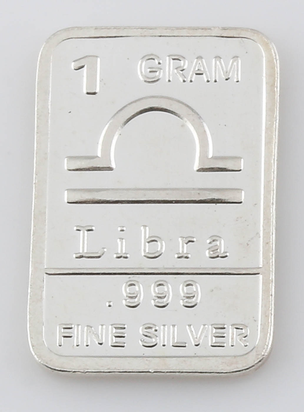 Group of Four One Gram Silver Rounds and Ingots