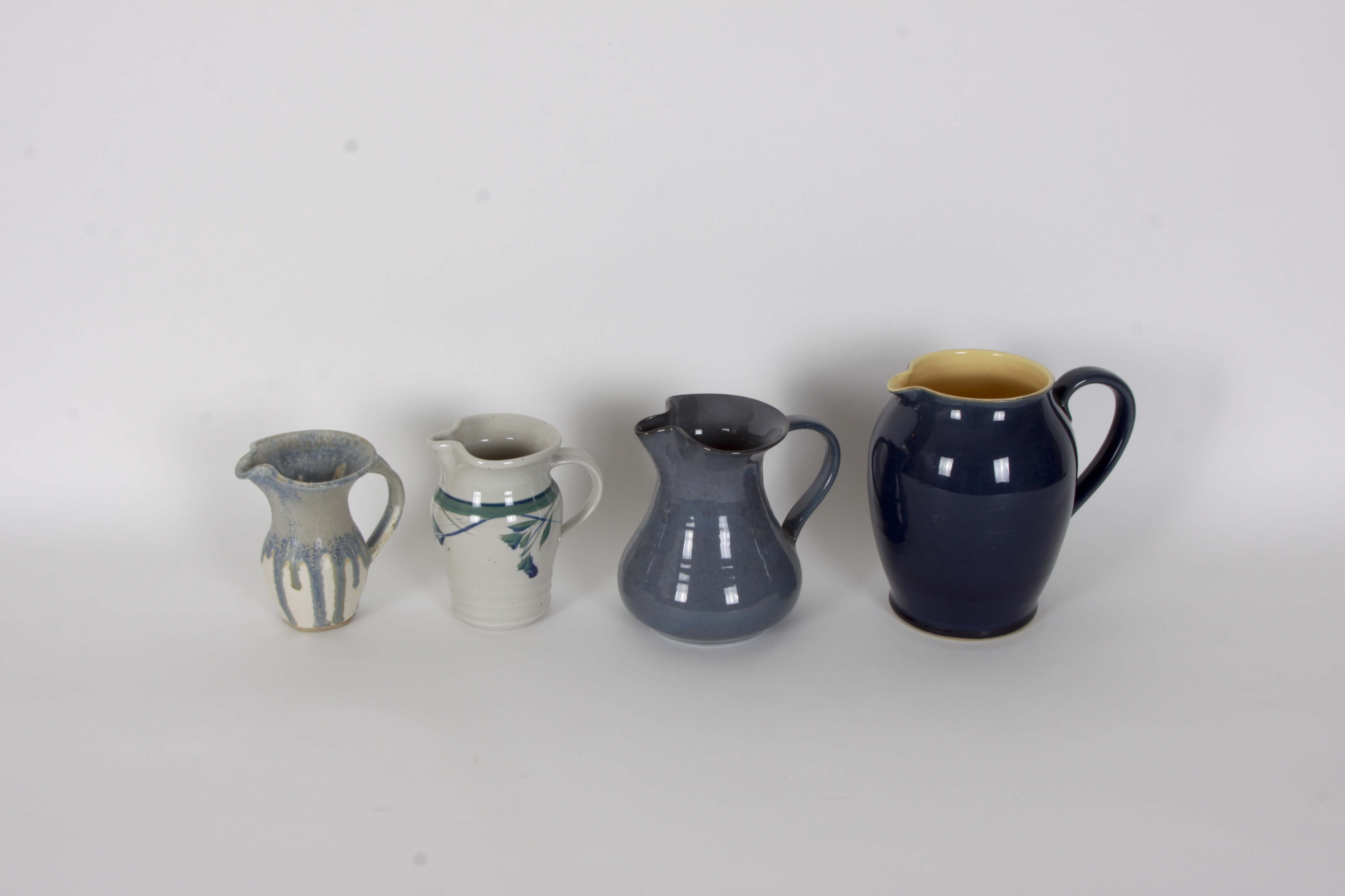 Hand Thrown Porcelain and Stoneware Pitchers