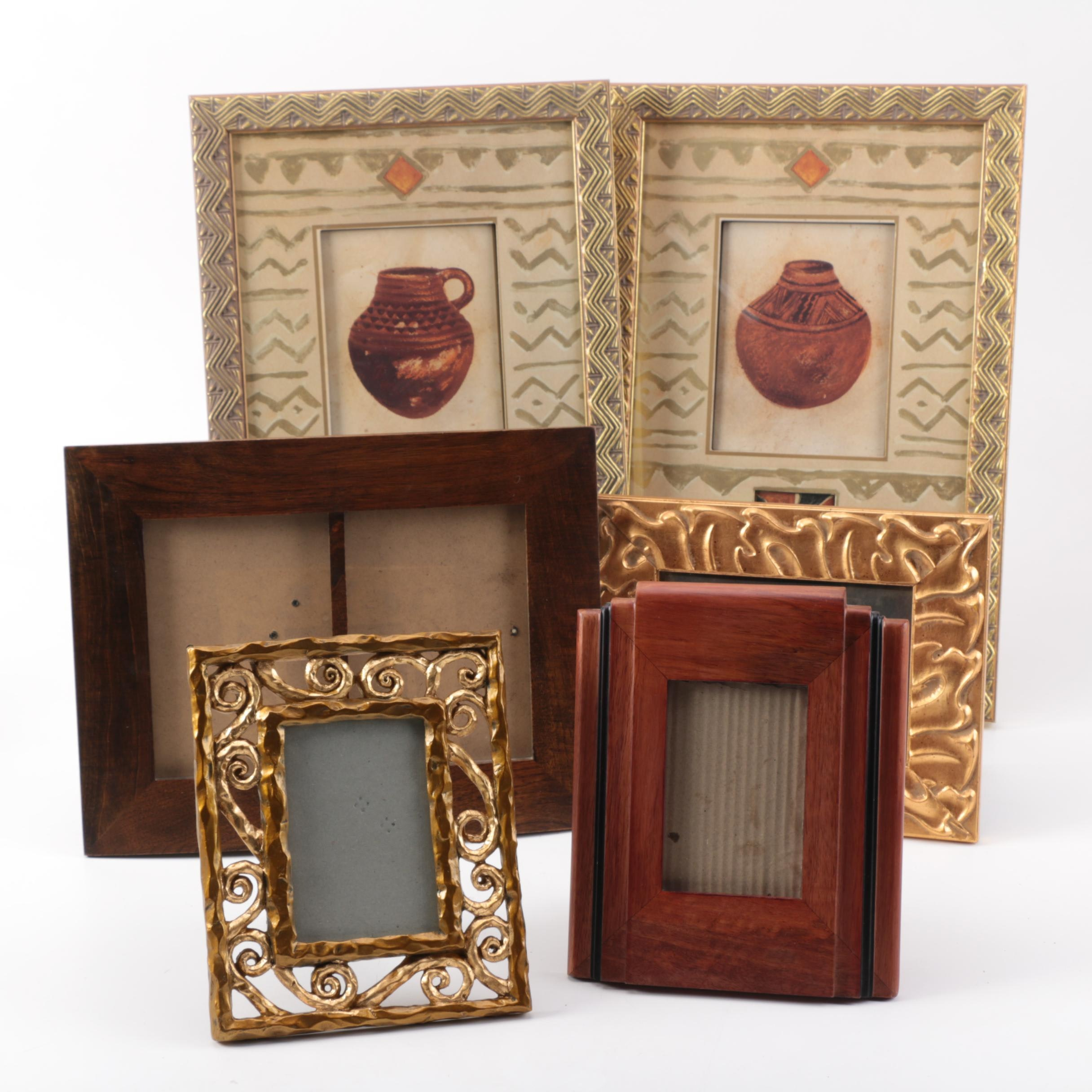 Four Picture Frames and Two Framed Prints Depicting Native American Style Vases