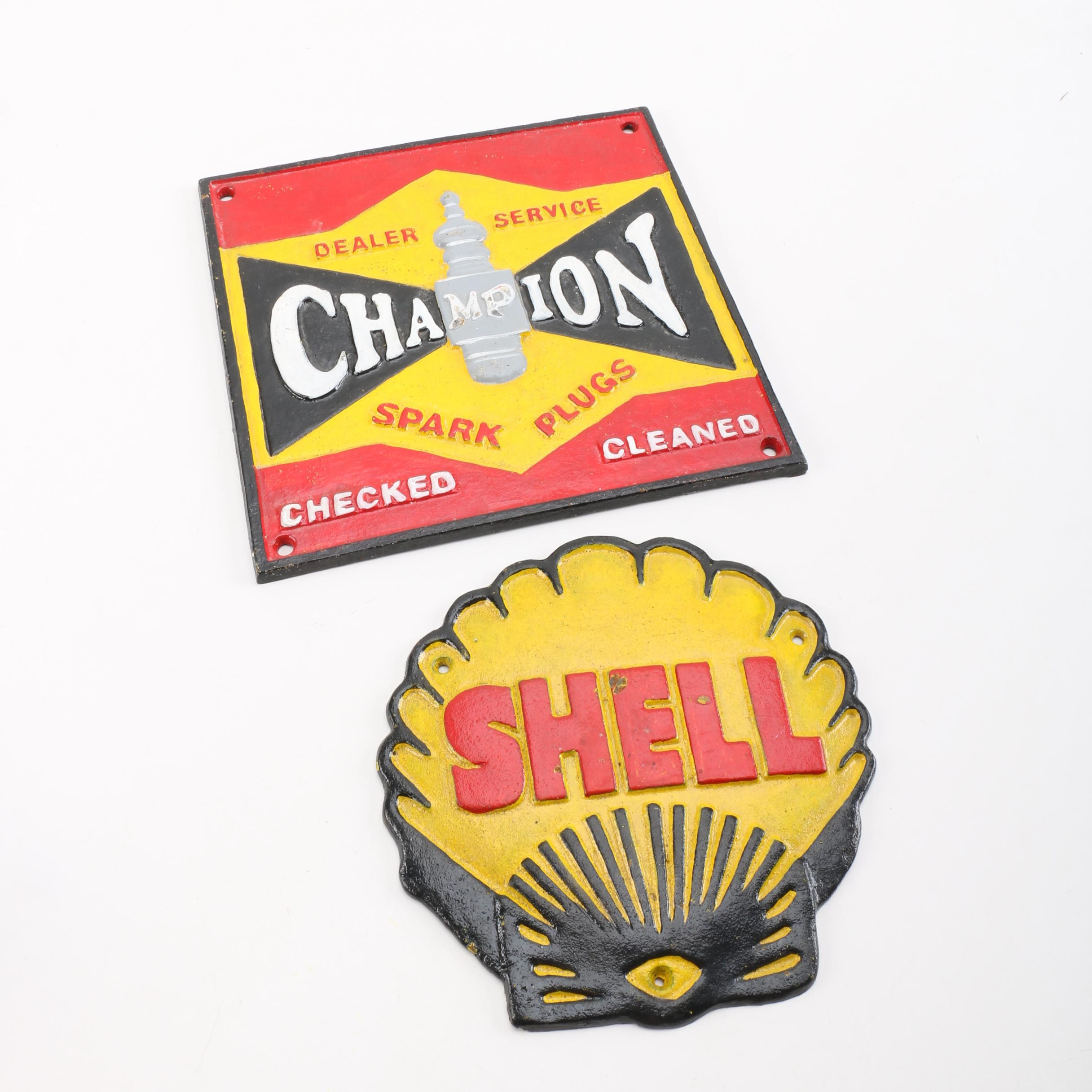 Cast Iron Shell Oil and Champion Sparks Signs