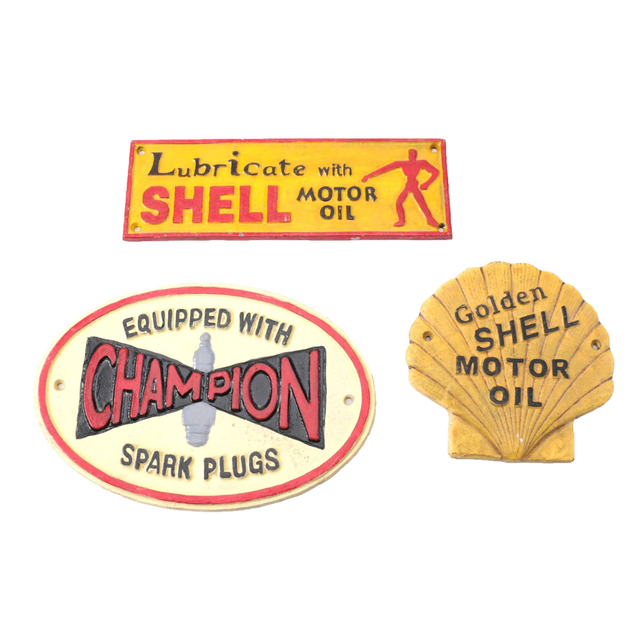 Cast Iron Signs for Shell Oil and Champion Spark Plugs