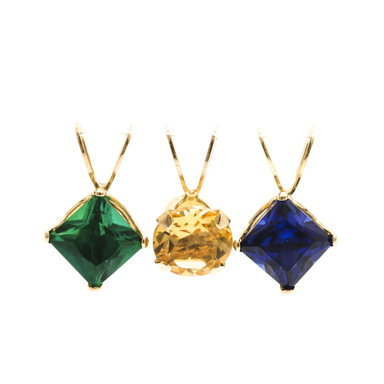 Assortment of 10K Yellow Gold Gemstone Pendants