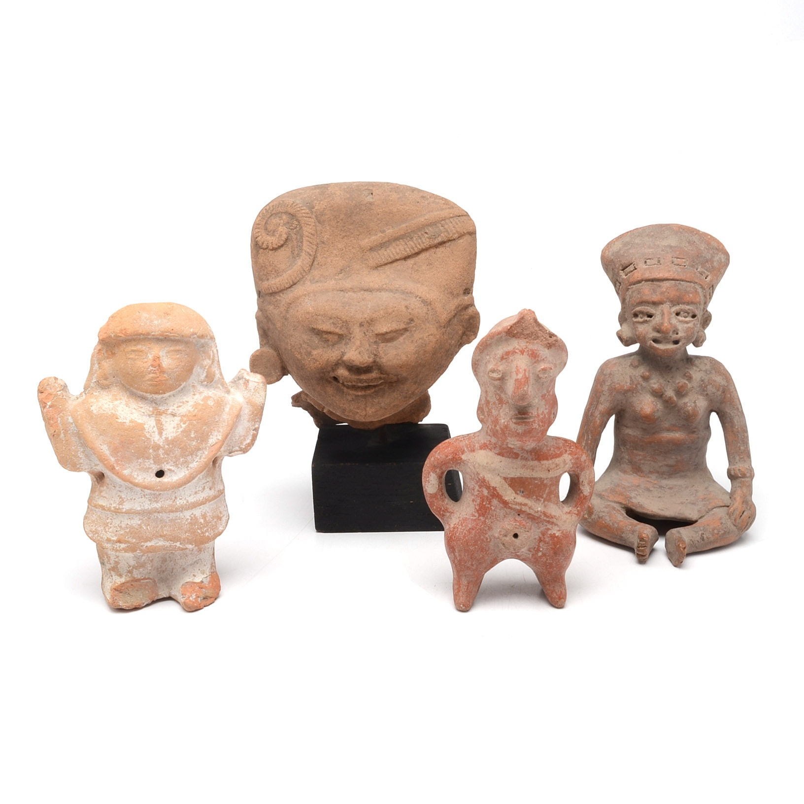 Group of Four Maya Stoneware Figurines