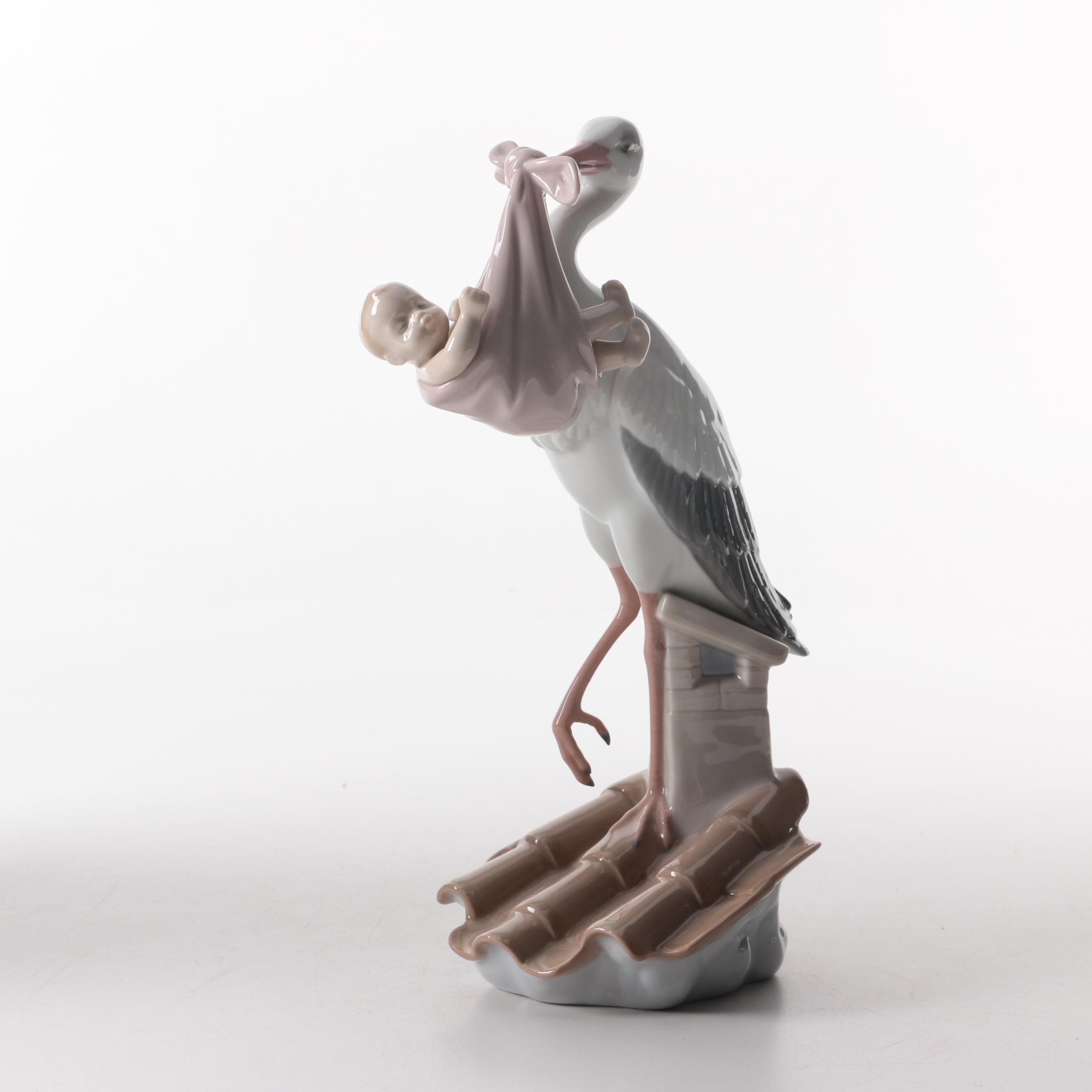 Lladro Stork with Baby Girl Figurine