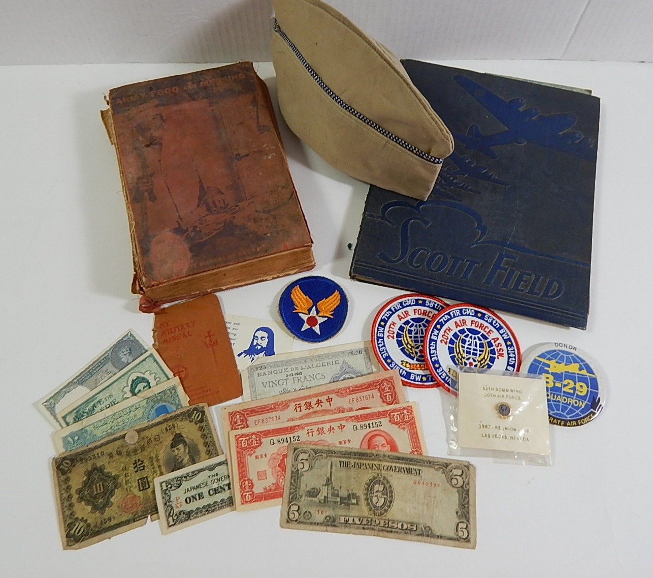 Military Collectibles with Paper Currency, Books, Patches, and More