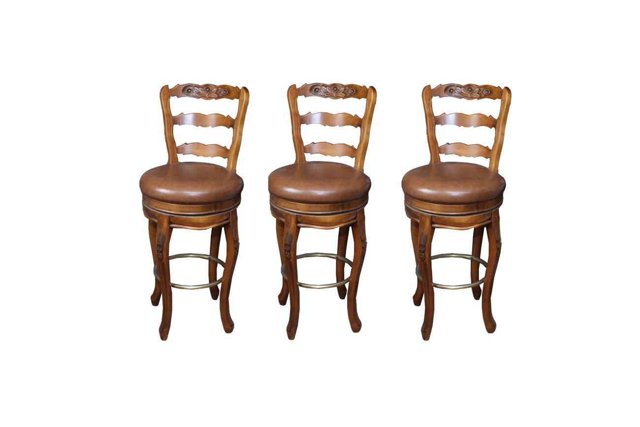 Three Swivel Leather Upholstered Counter Stools