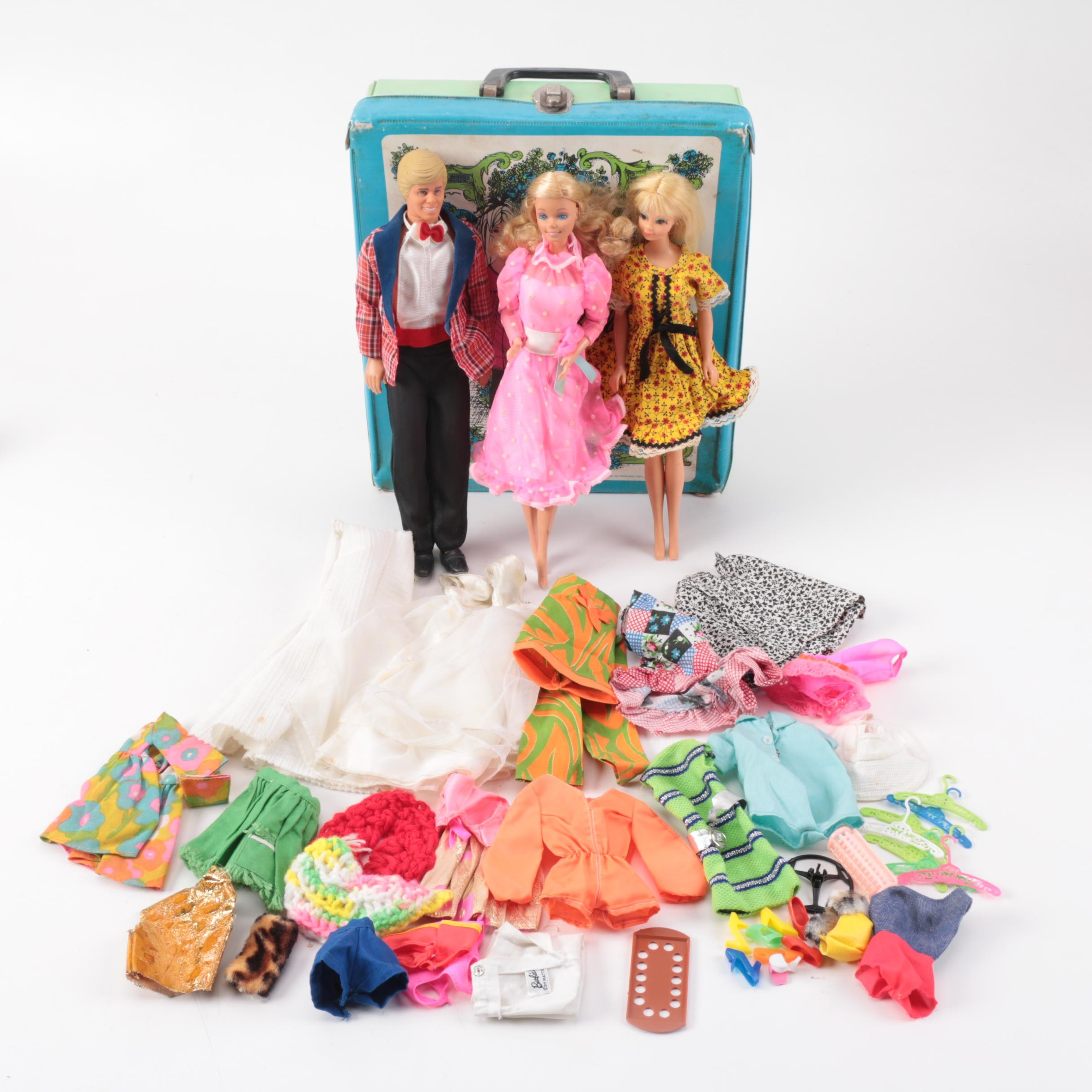 The World of Barbie Doll Case with Three Dolls and Various Accessories