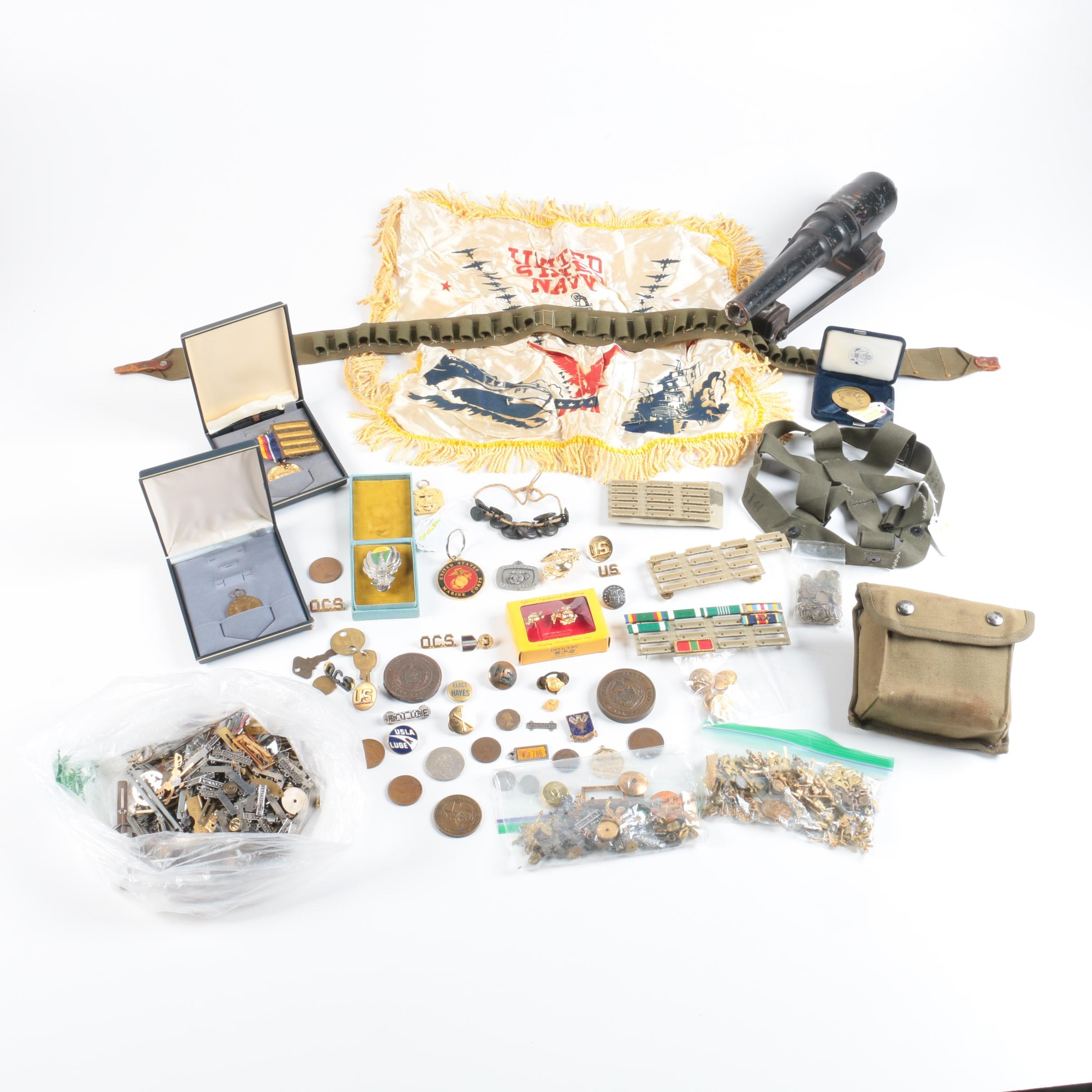Military Accessories Lot with Medals, Pins, Coins, Webbing, and a Toy Cannon
