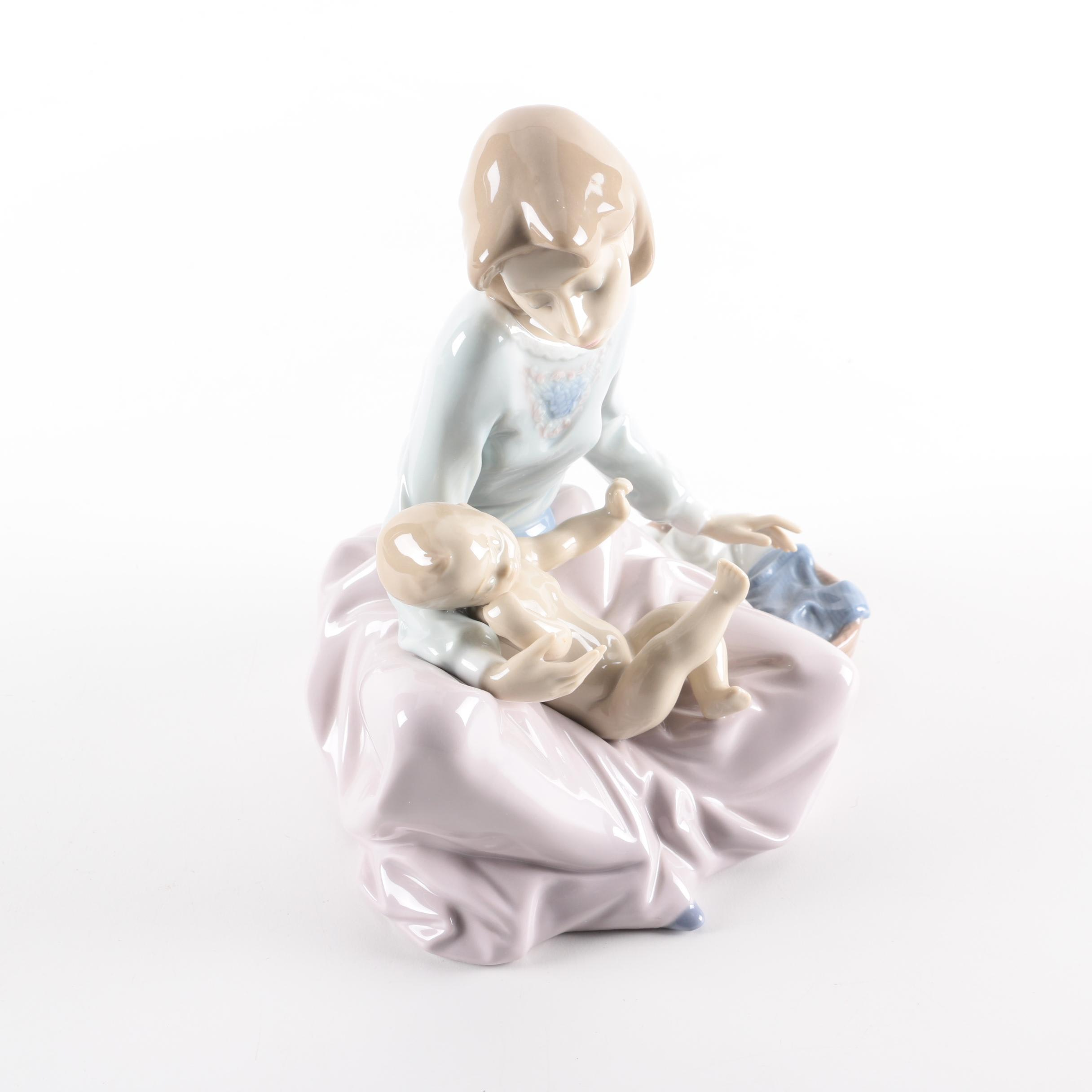 "Lladró ""Dressing the Baby"" Porcelain Figurine"