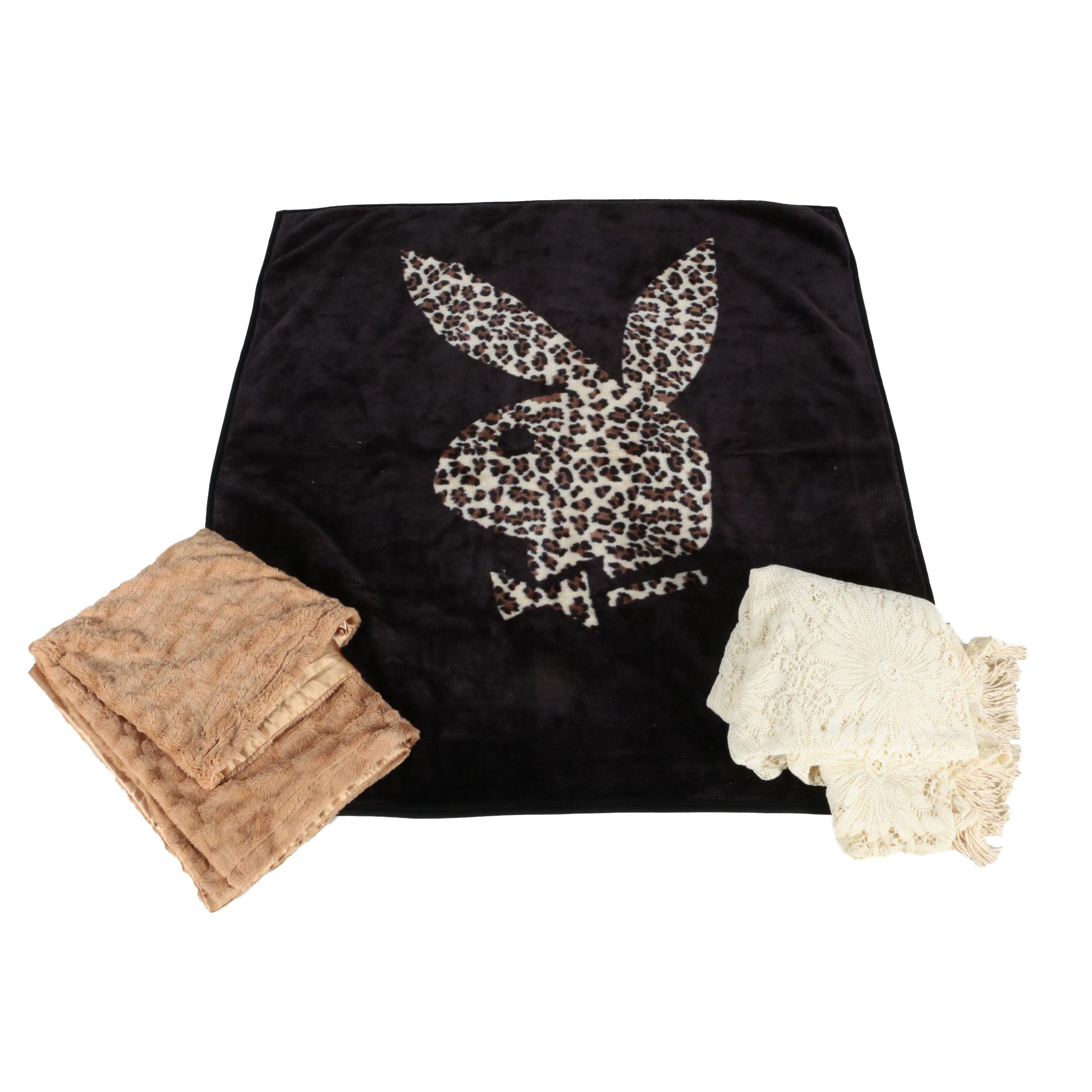 Plush Blankets Featuring Playboy and a Lace Bedspread