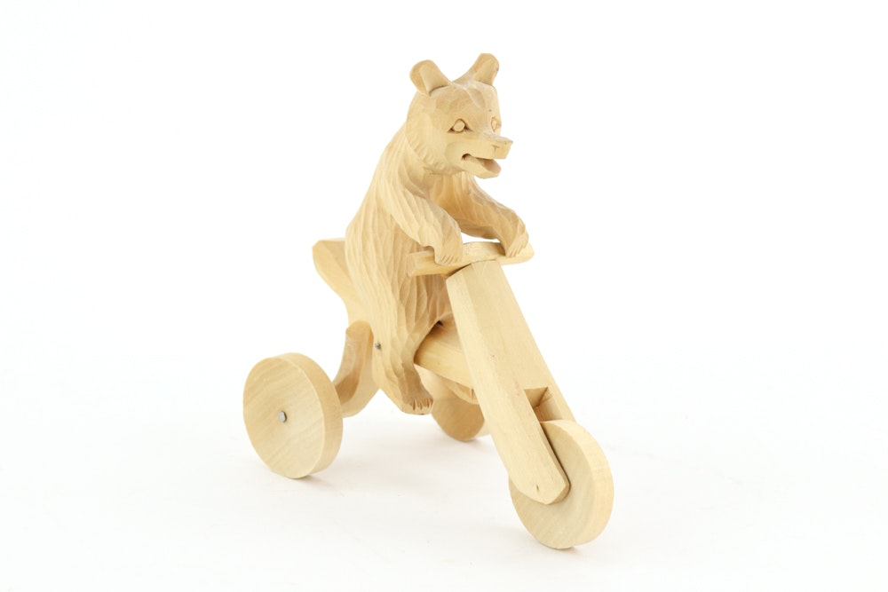 Carved Wooden Sculpture of Bear on a Tricycle