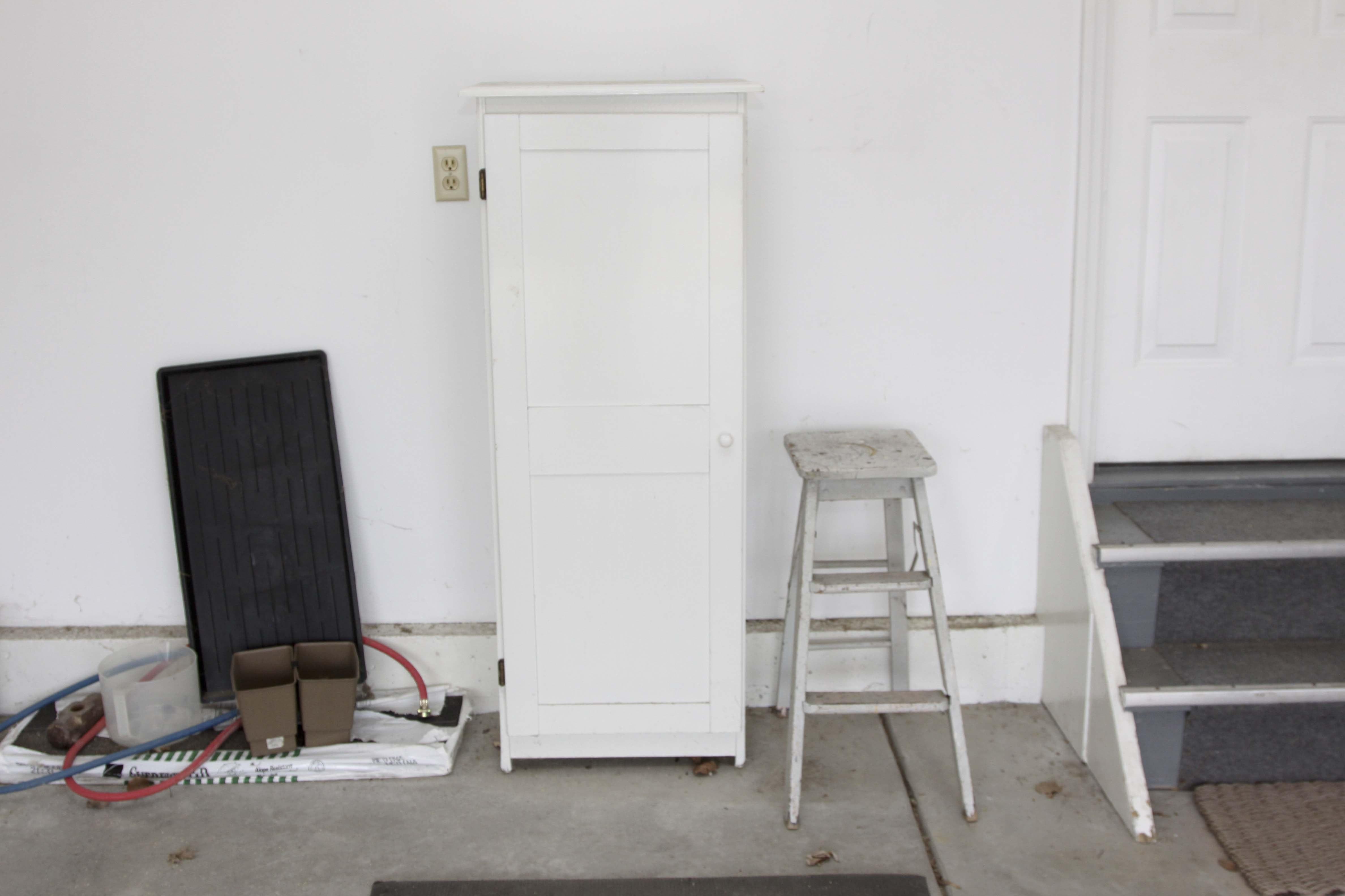 Cabinet and Vintage Step Ladder