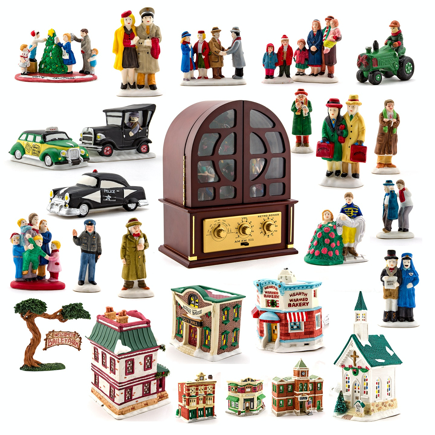 """""""It's A Wonderful Life"""" Ceramic Holiday Town and Reproduction AM/FM Radio"""