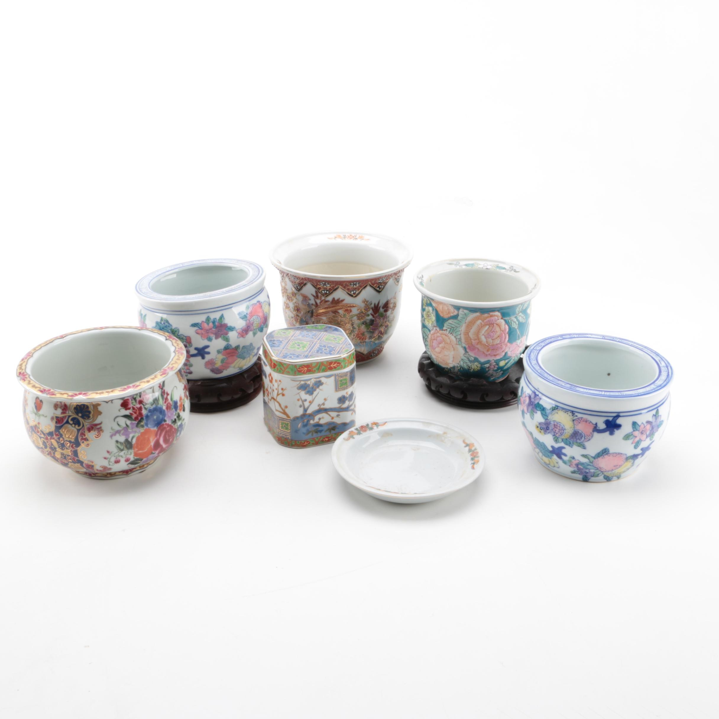 East Asian Porcelain Planters, Canister, Plate, and Carved Wood Stands