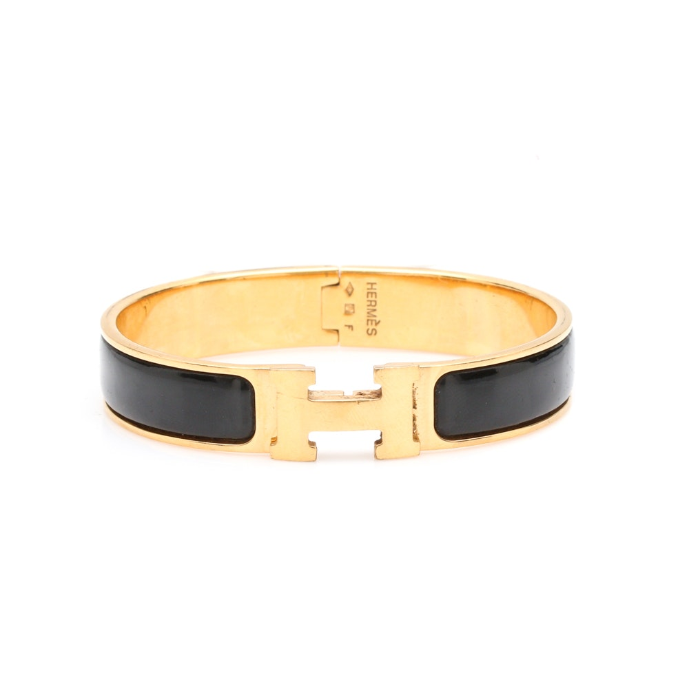 "Hermès ""Clic H"" 18K Gold Plated and Black Enamel Bangle Bracelet"
