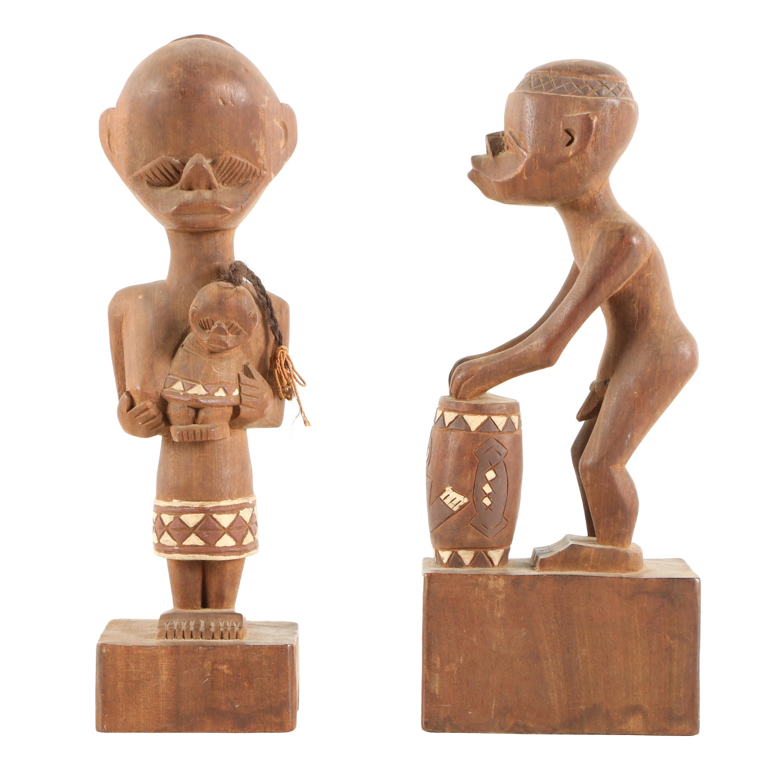 Wood Carvings of Drummer and Mother with Child