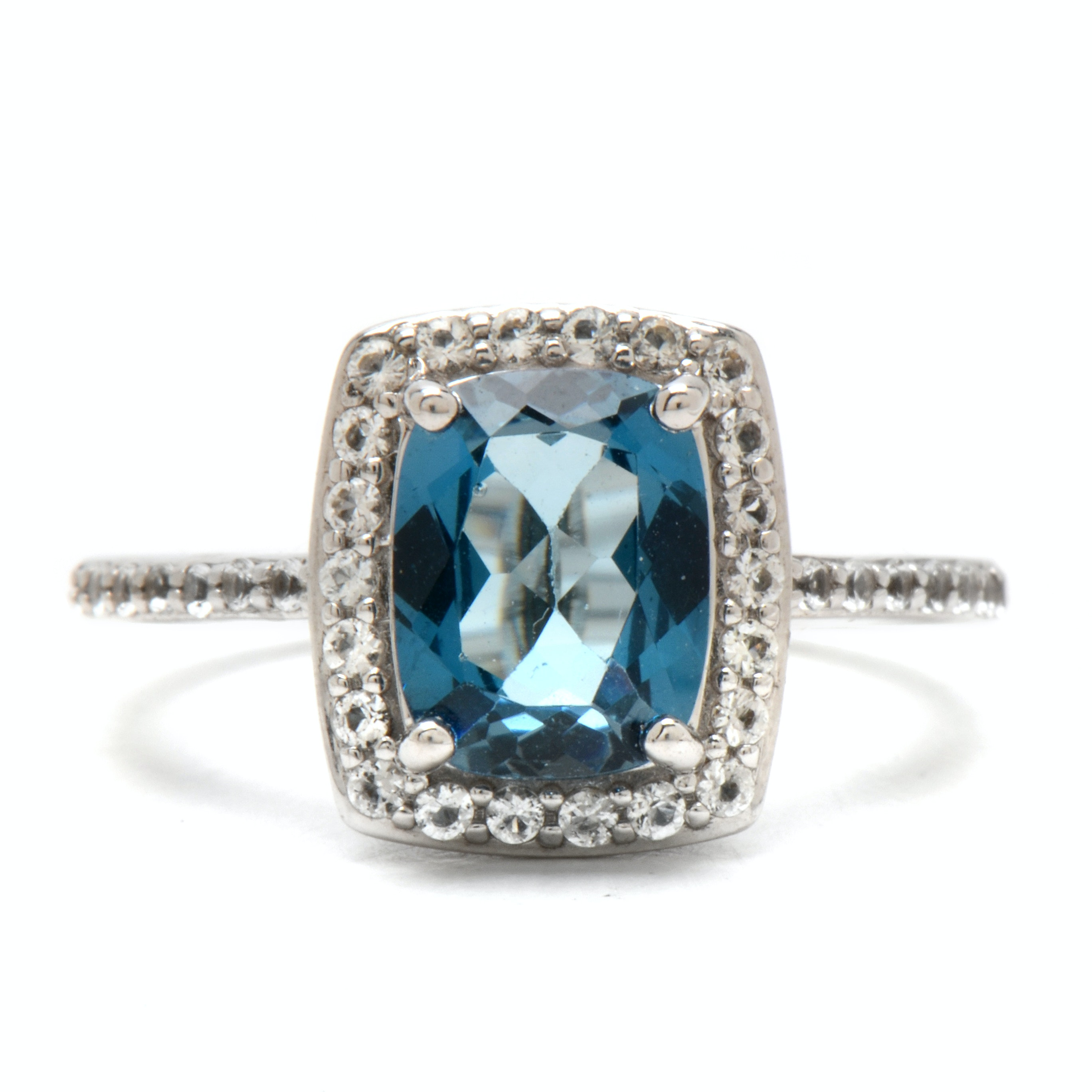Sterling Silver Ring Featuring Blue and White Topaz Stones