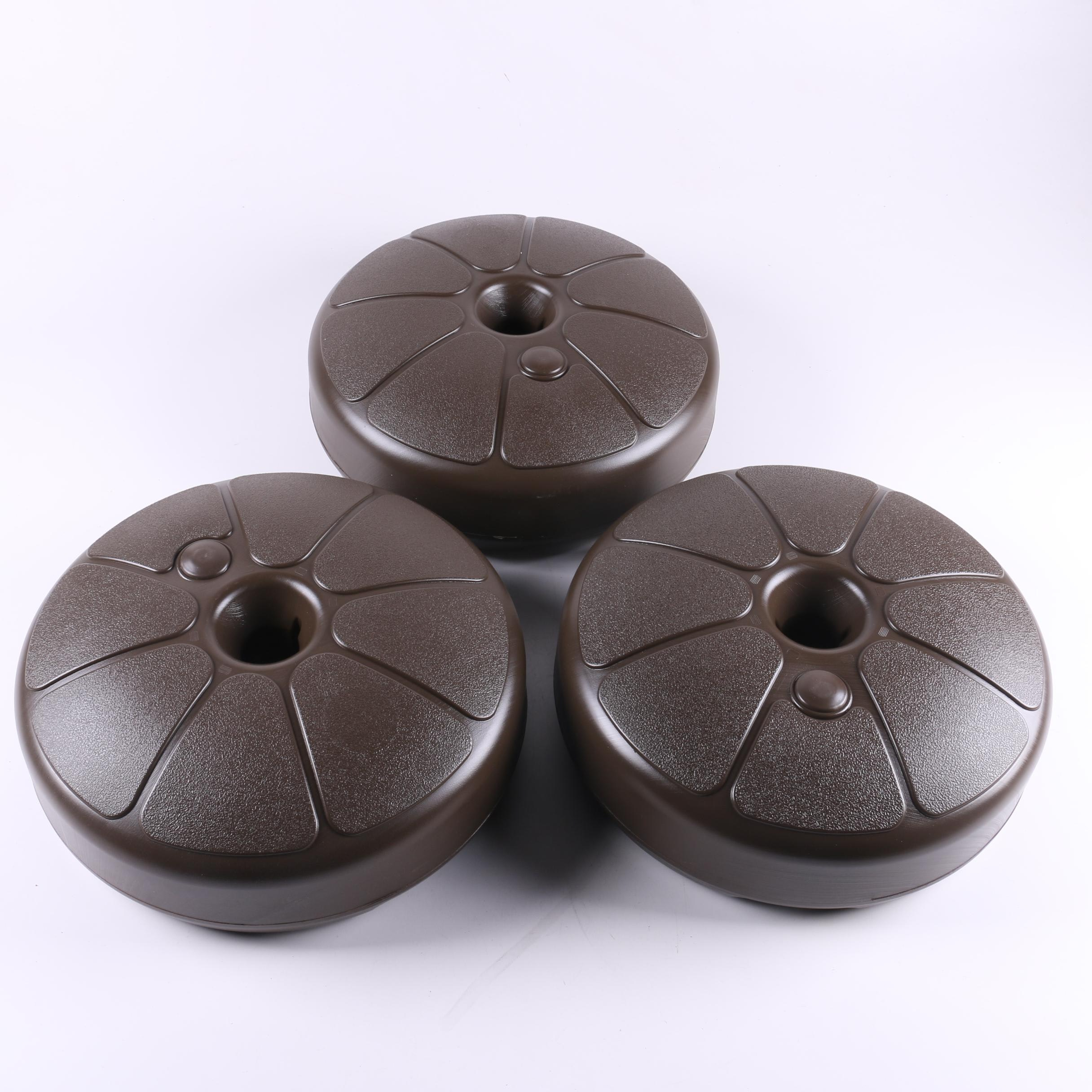 Three Brown Umbrella Bases by Adams