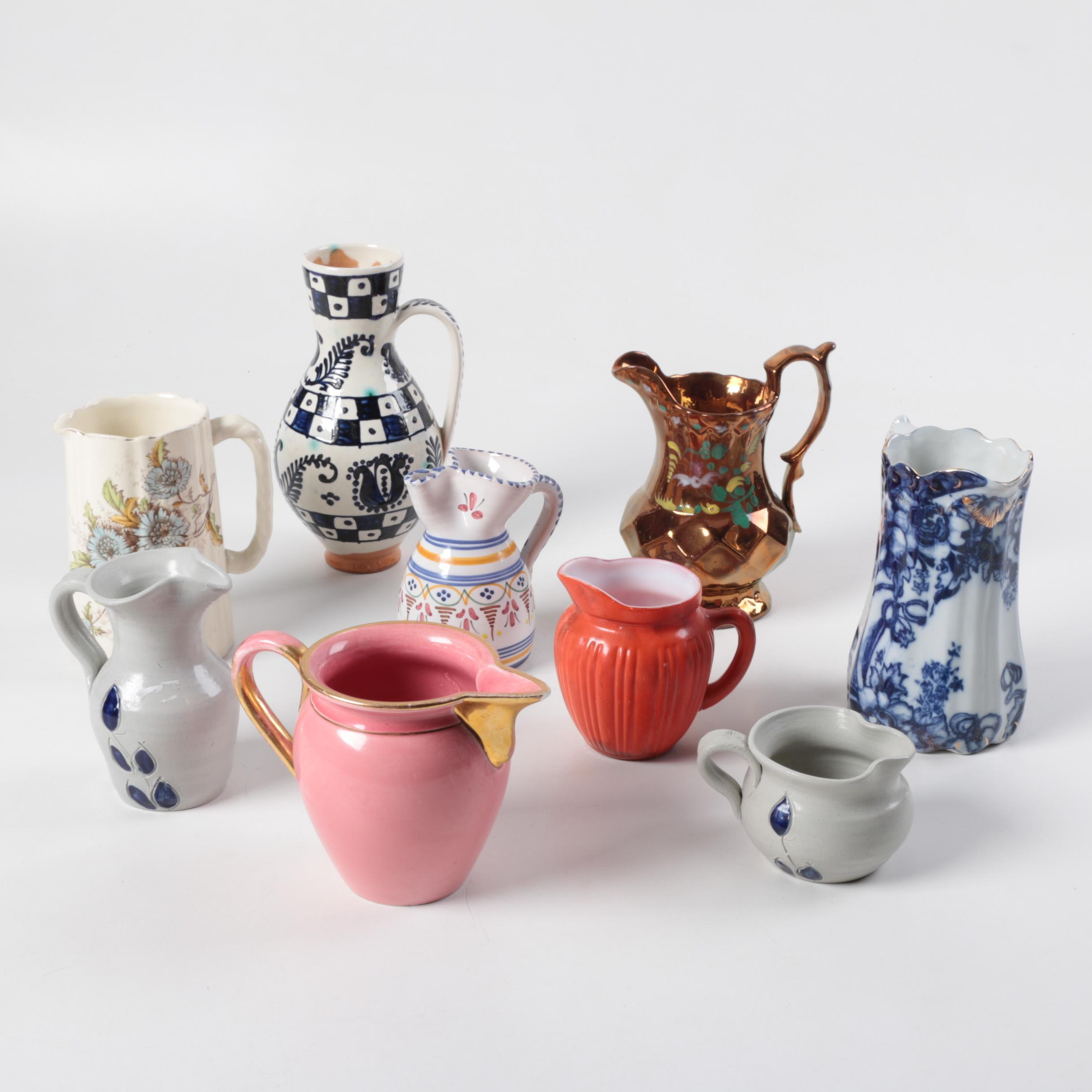 Decorative Ceramic and Glass Pitchers featuring Royal Doulton