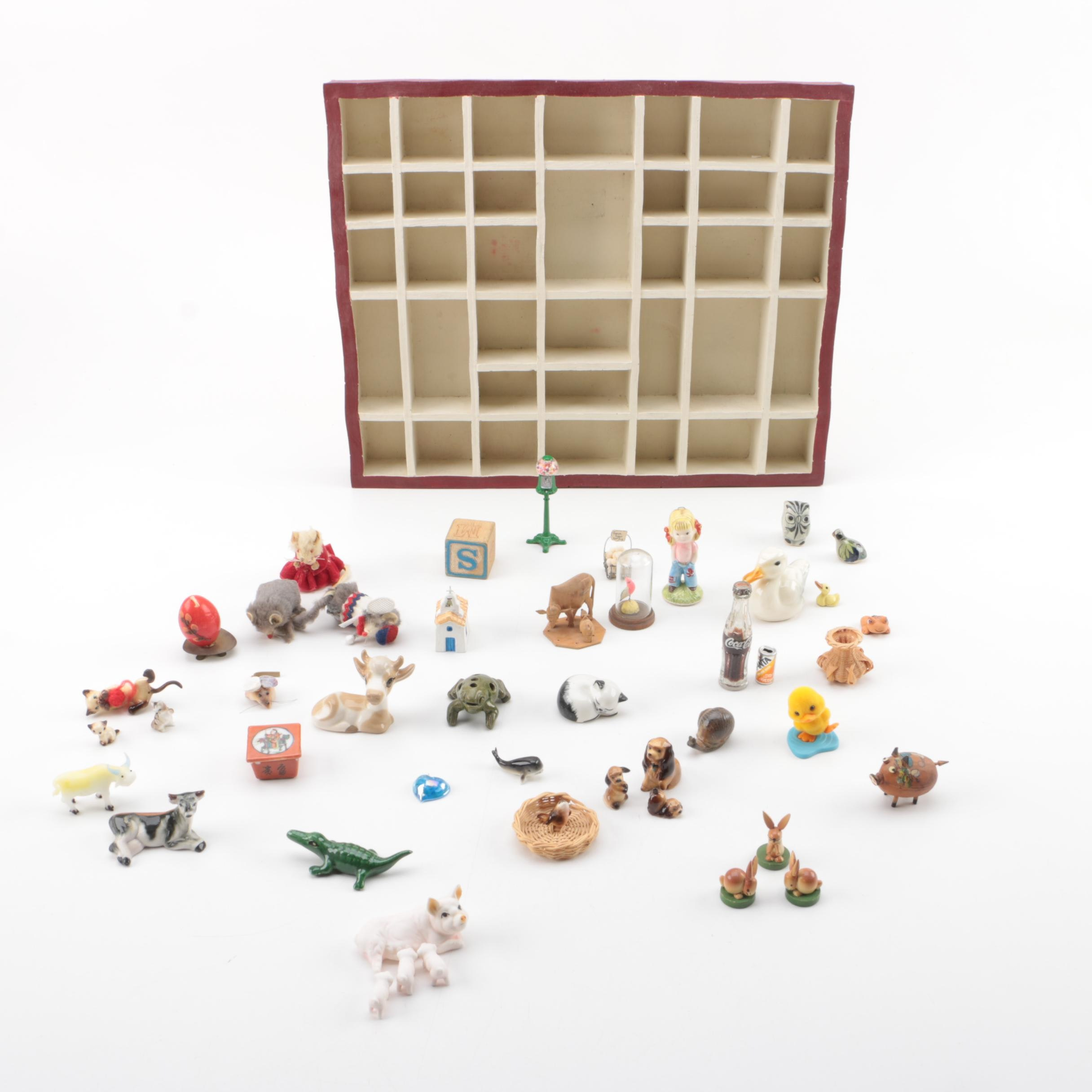 Vintage Figurines Featuring Goebel and a Display Shelf