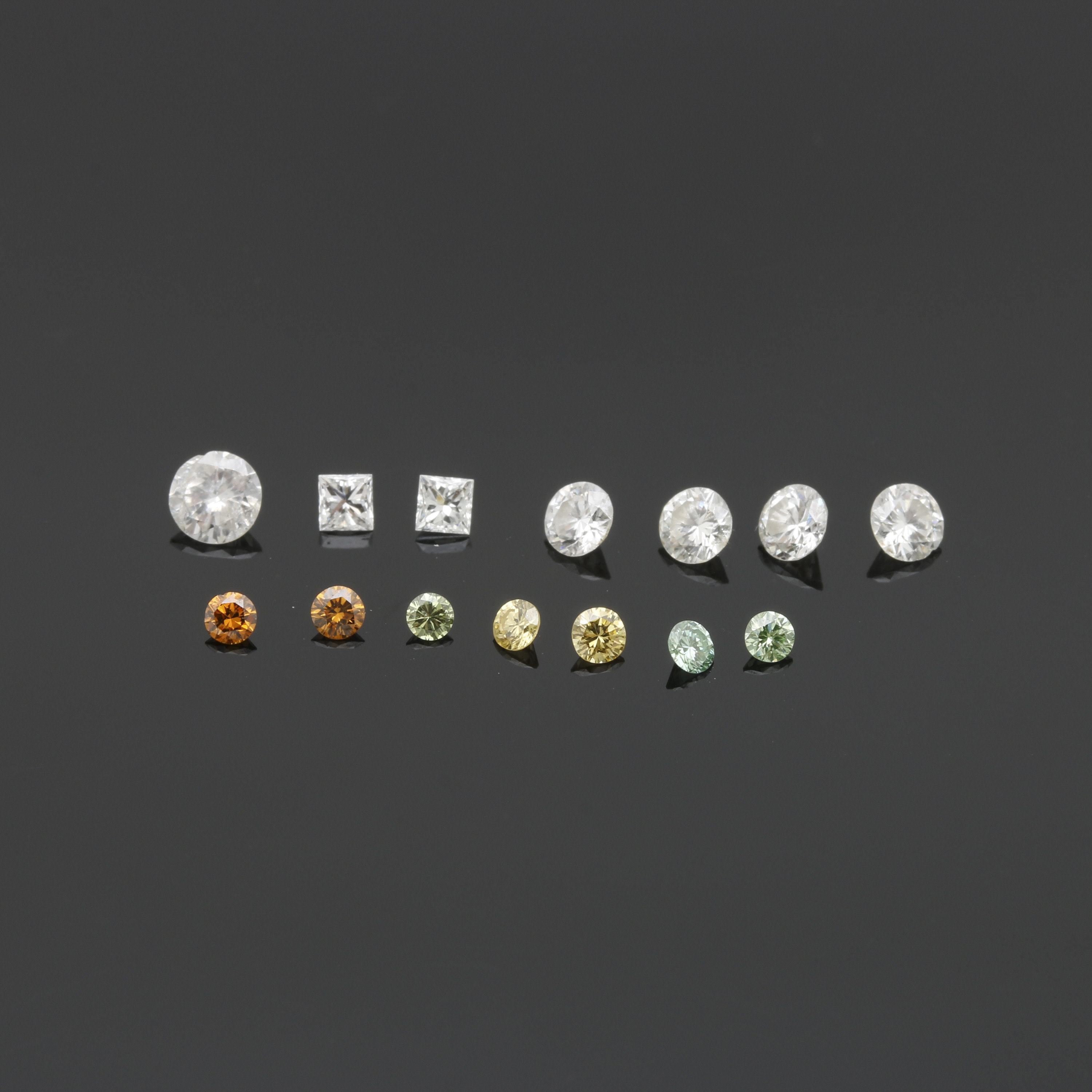 Assortment of 1.19 CTW Loose Diamonds Including Irradiated Colors