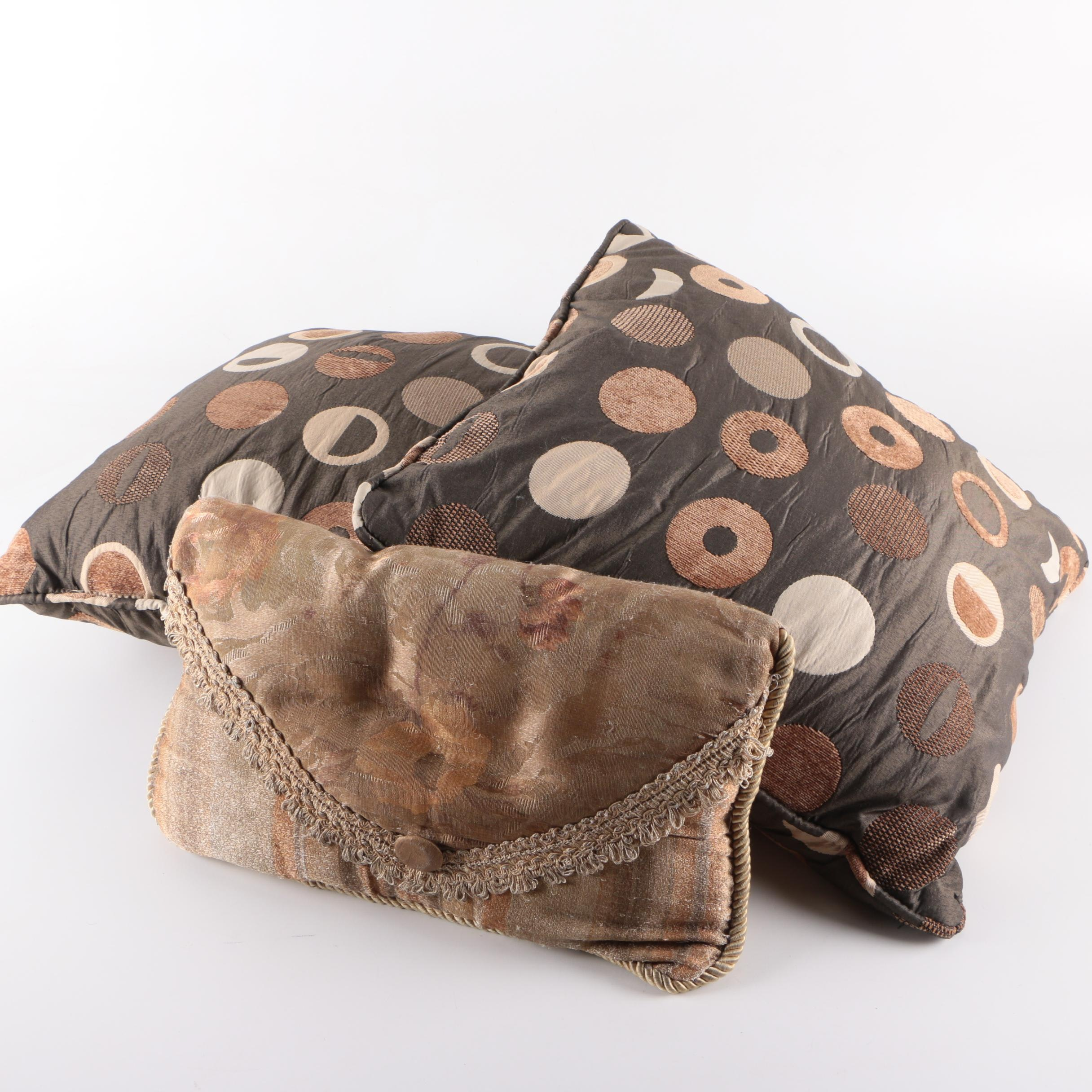 Brown and Beige Throw Pillows with Geometric Designs