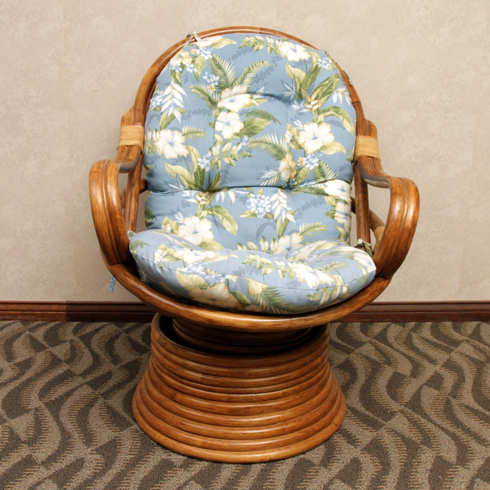 Rattan Swivel Chair with Floral Cushion
