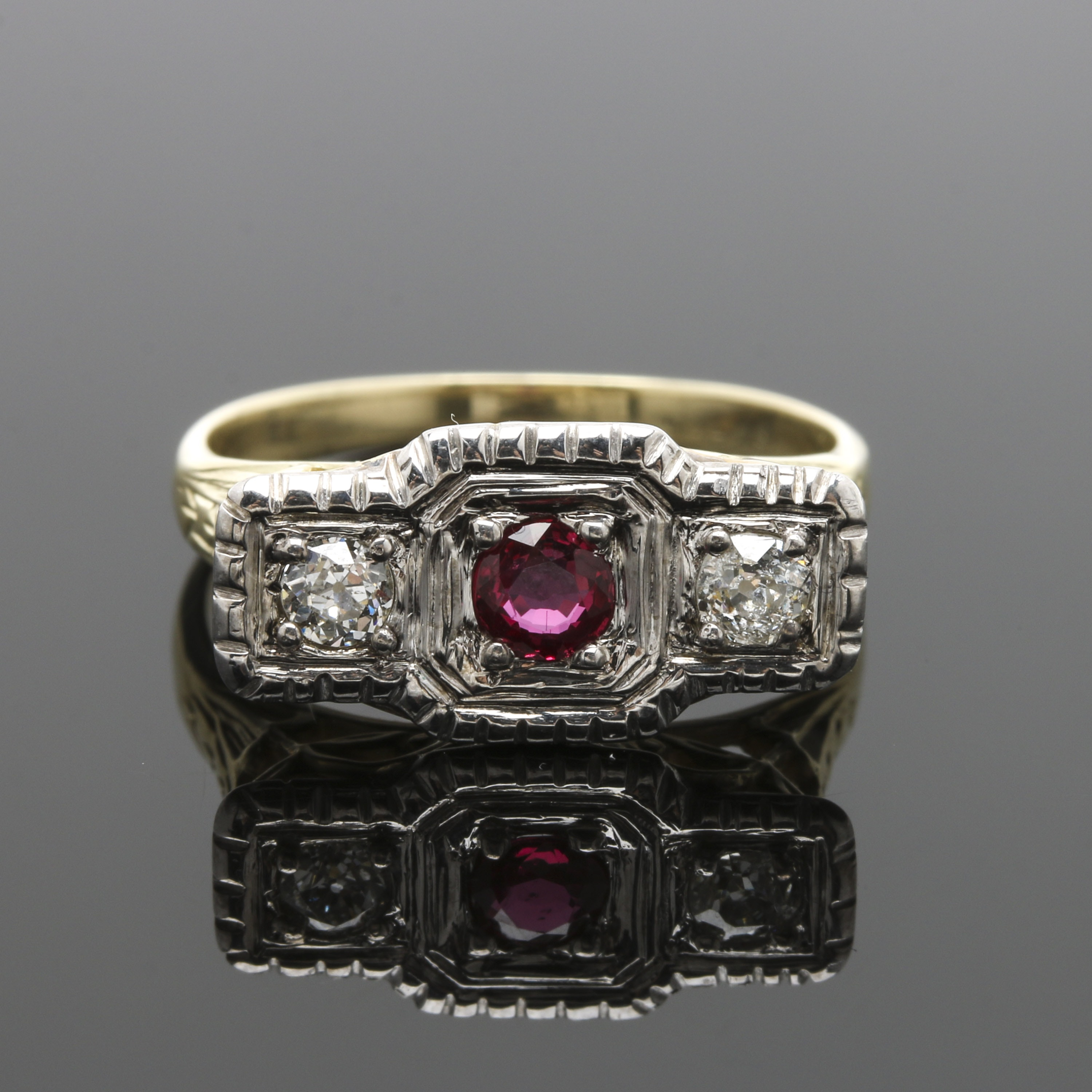Circa 1910s Ostby & Barton 14K and 18K Two Tone Gold Ruby and Diamond Ring