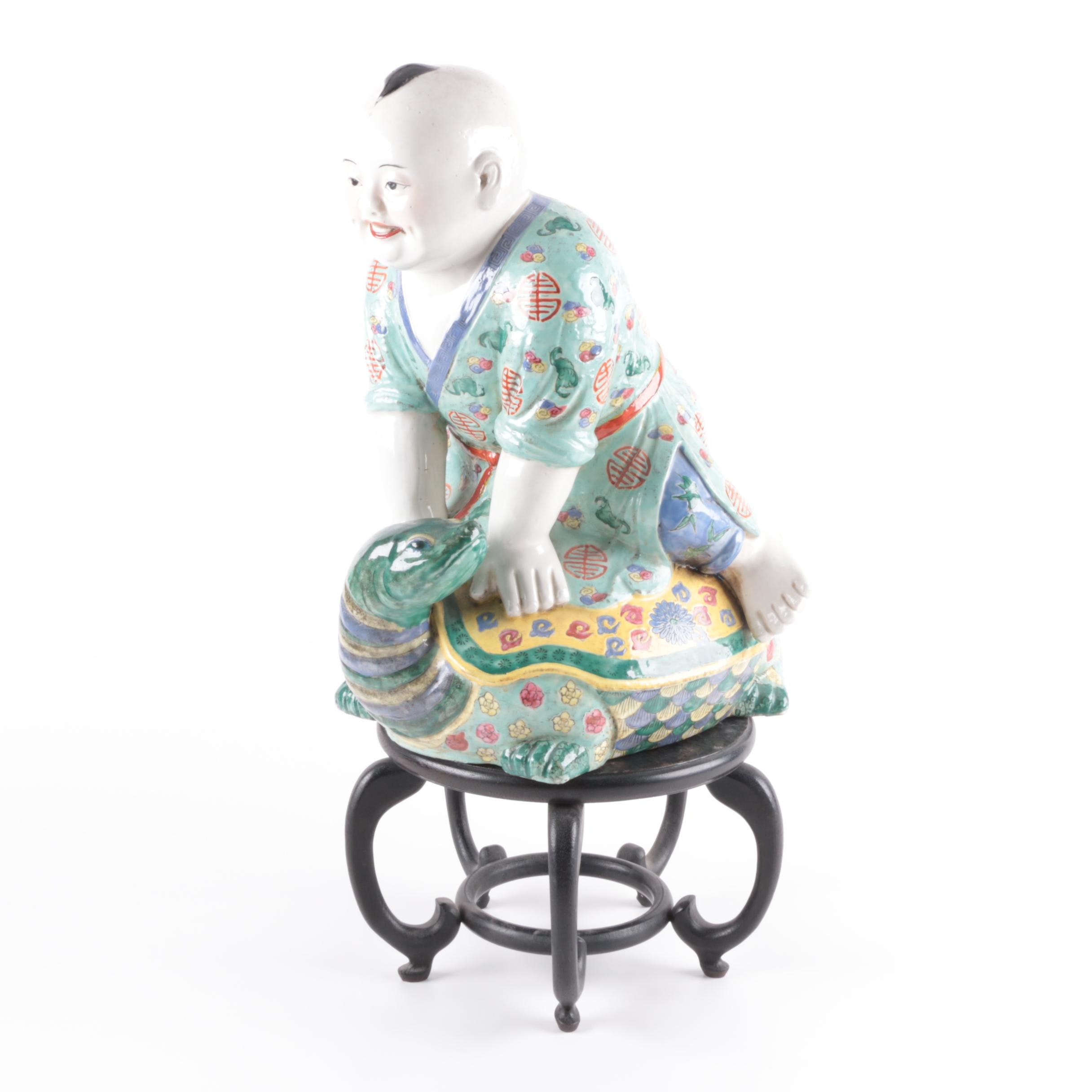 Chinese Figurine of Boy on Turtle with Wood Stand