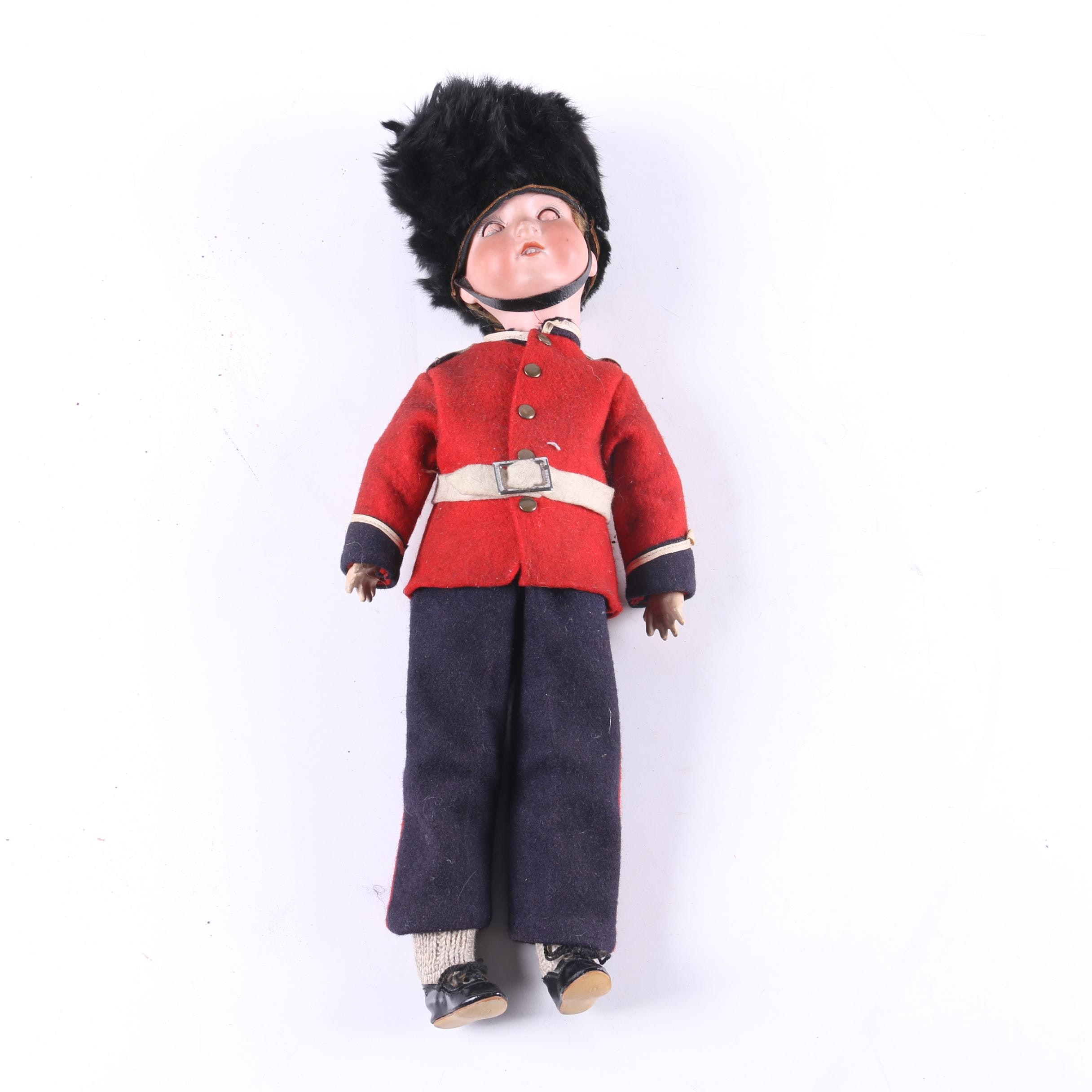 Antique Bisque and Composition British Soldier Doll